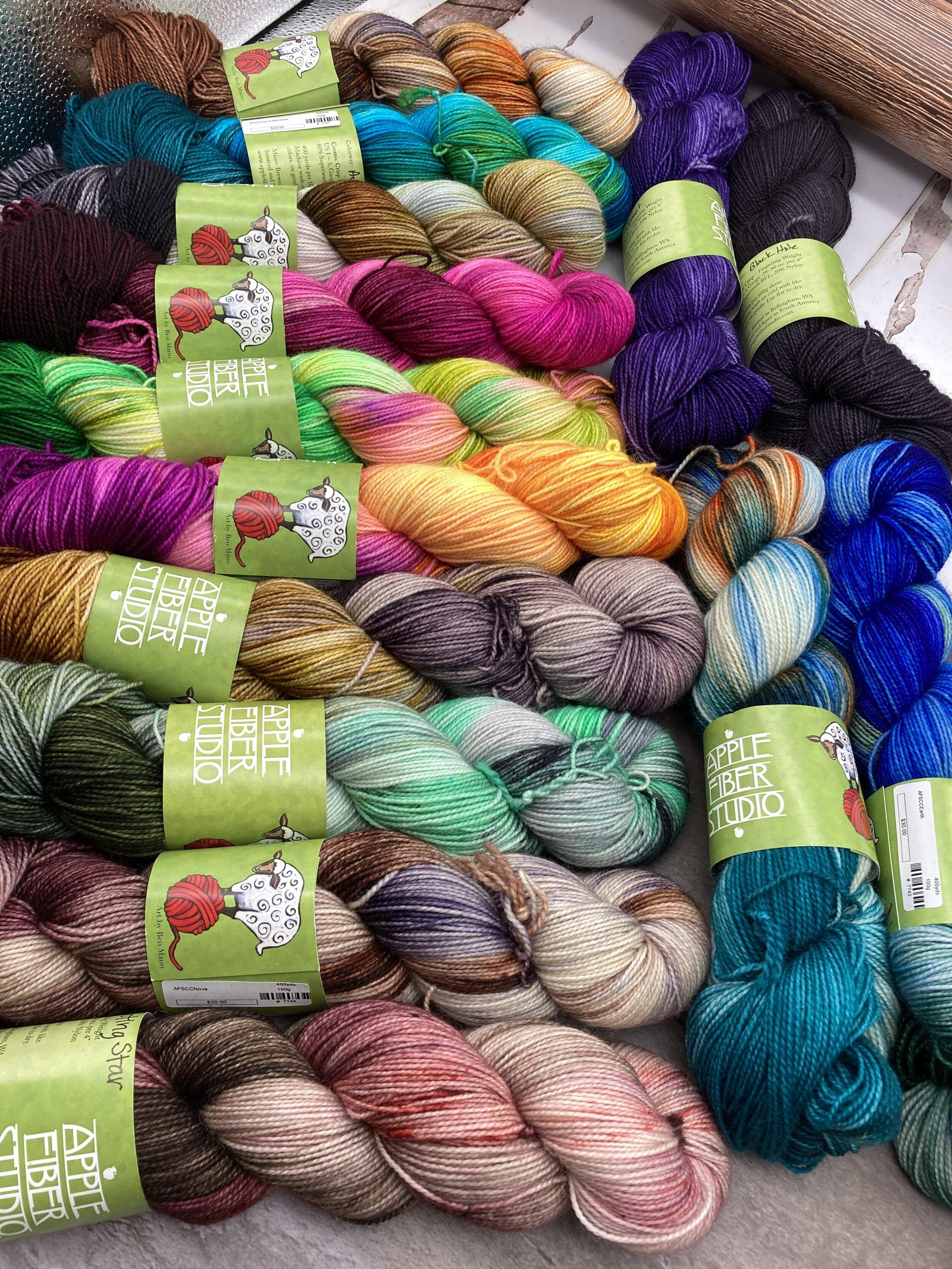 14 colors of Apple Fiber Studios Cosmic Crisp fingering weight yarn