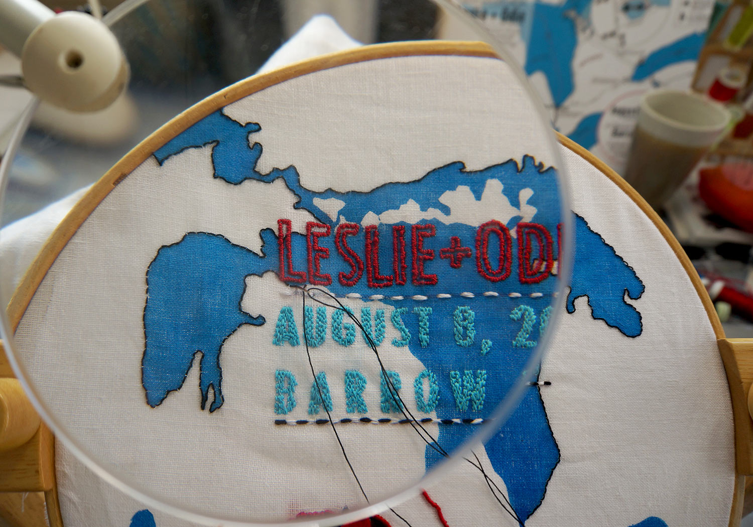 At work on the embroidery using a frame stand and magnifying lens