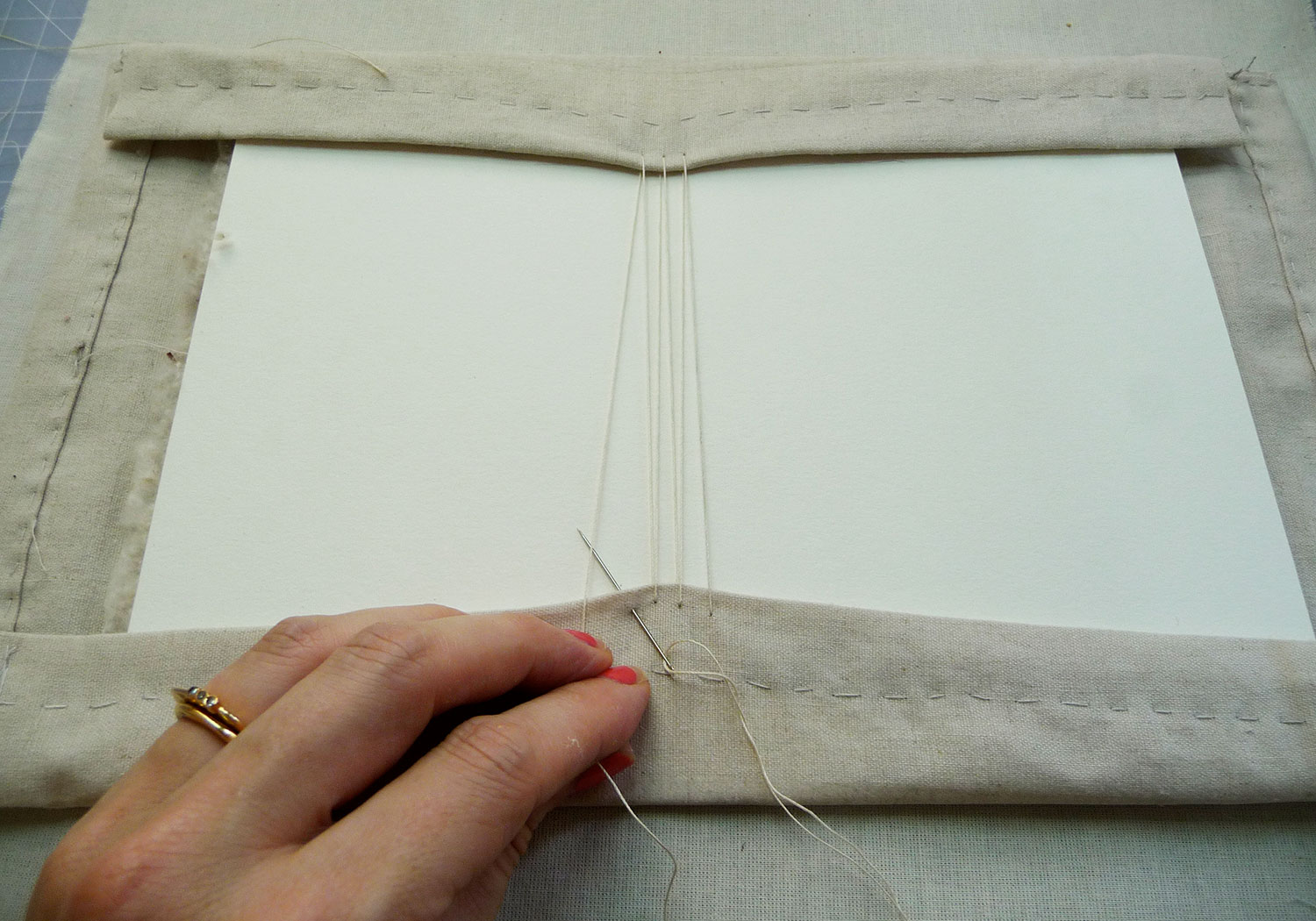 Lacing the embroidery, which is the safest (and most time-consuming) mounting method
