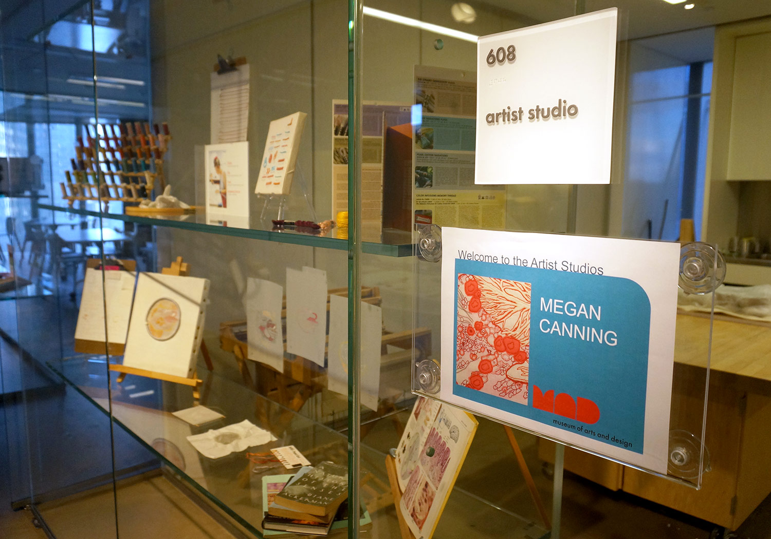 The entrance to the studio is flanked by display shelves for each resident artist to showcase their tools, materials, sources of inspiration, and other work