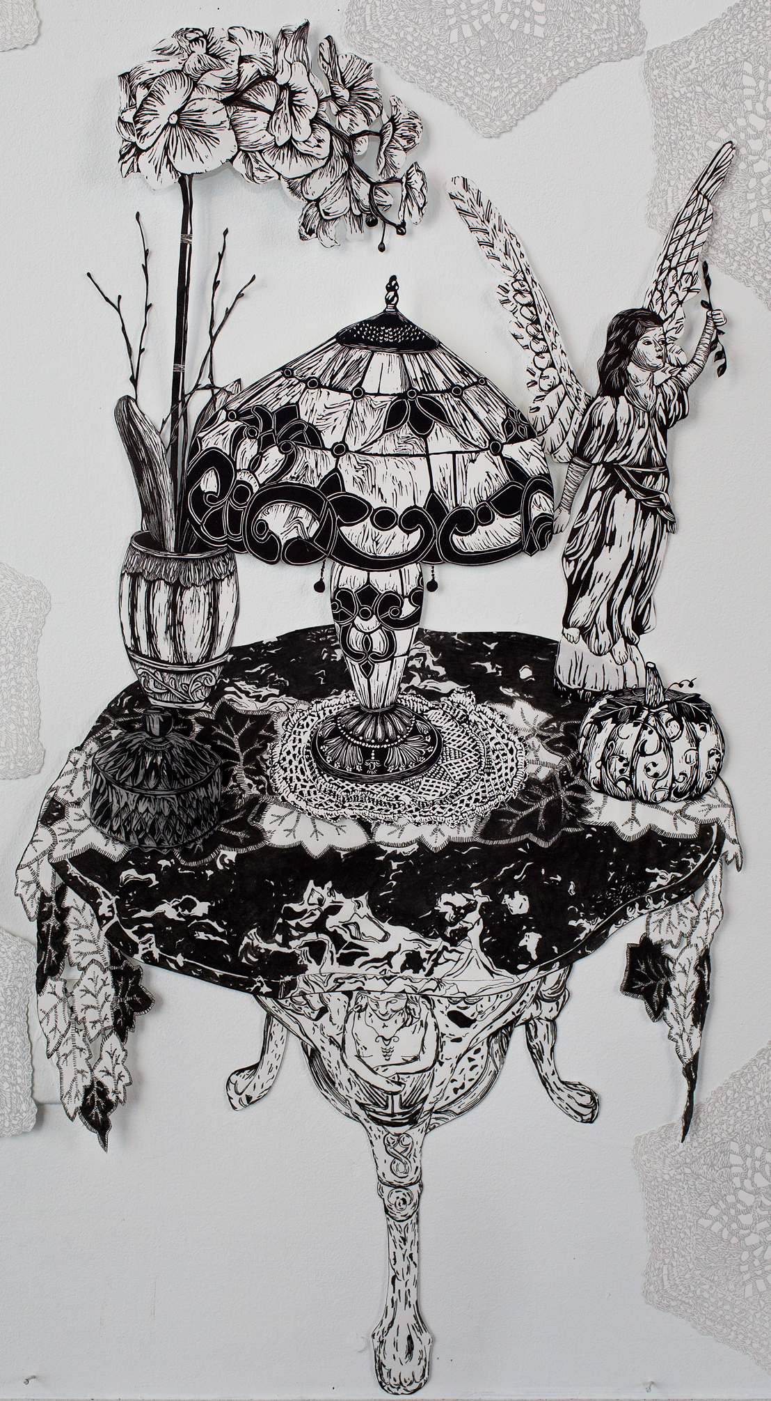 """""""Angelic Marble Table"""", table is pen drawing, objects are linoleum relief, 20 1/2x40. Each piece is hand cut out with Xacto."""
