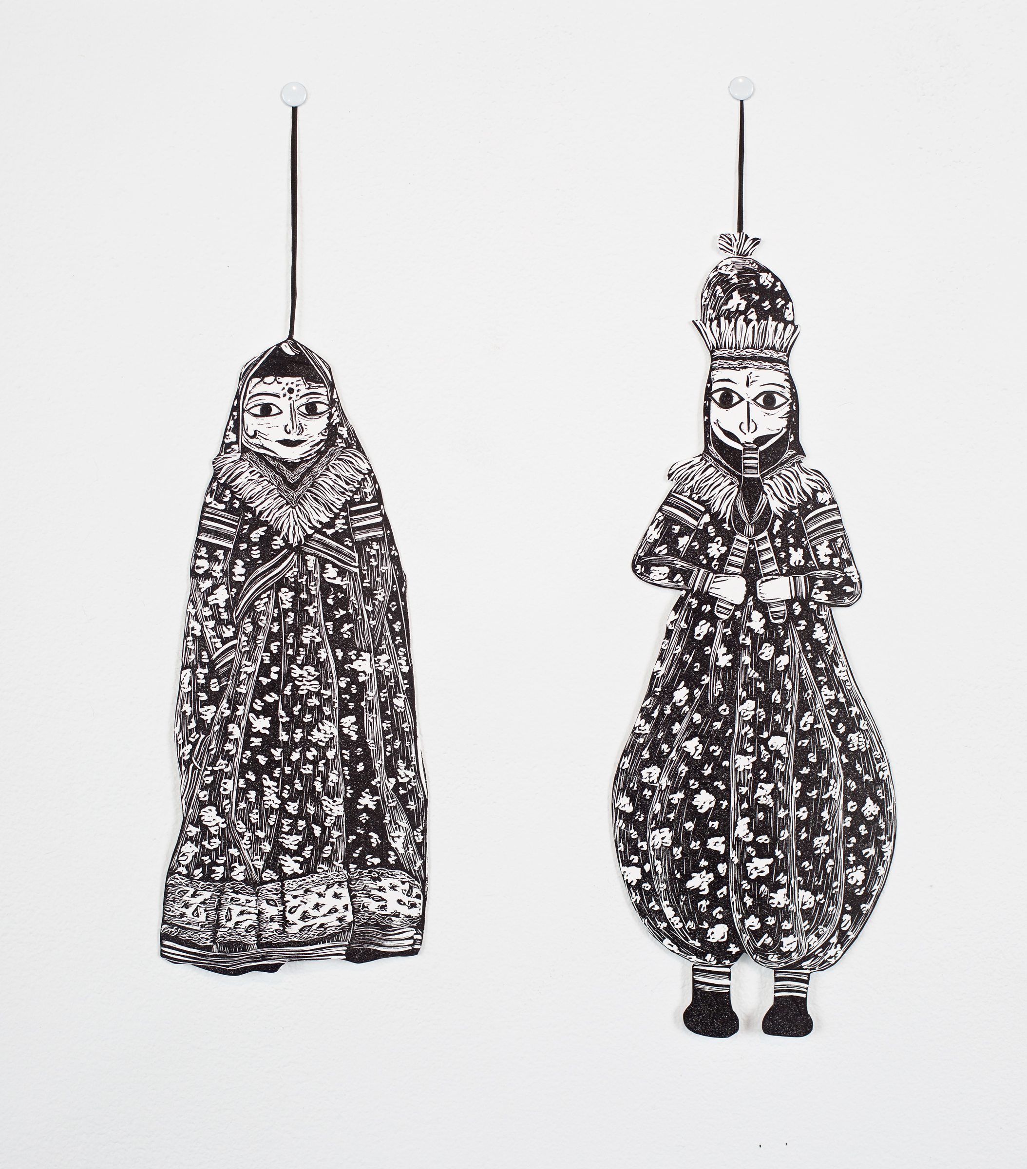 """""""Rajasthani Puppets"""", linoleum relief and hand cut out with Xacto, each puppet is around 4x10"""