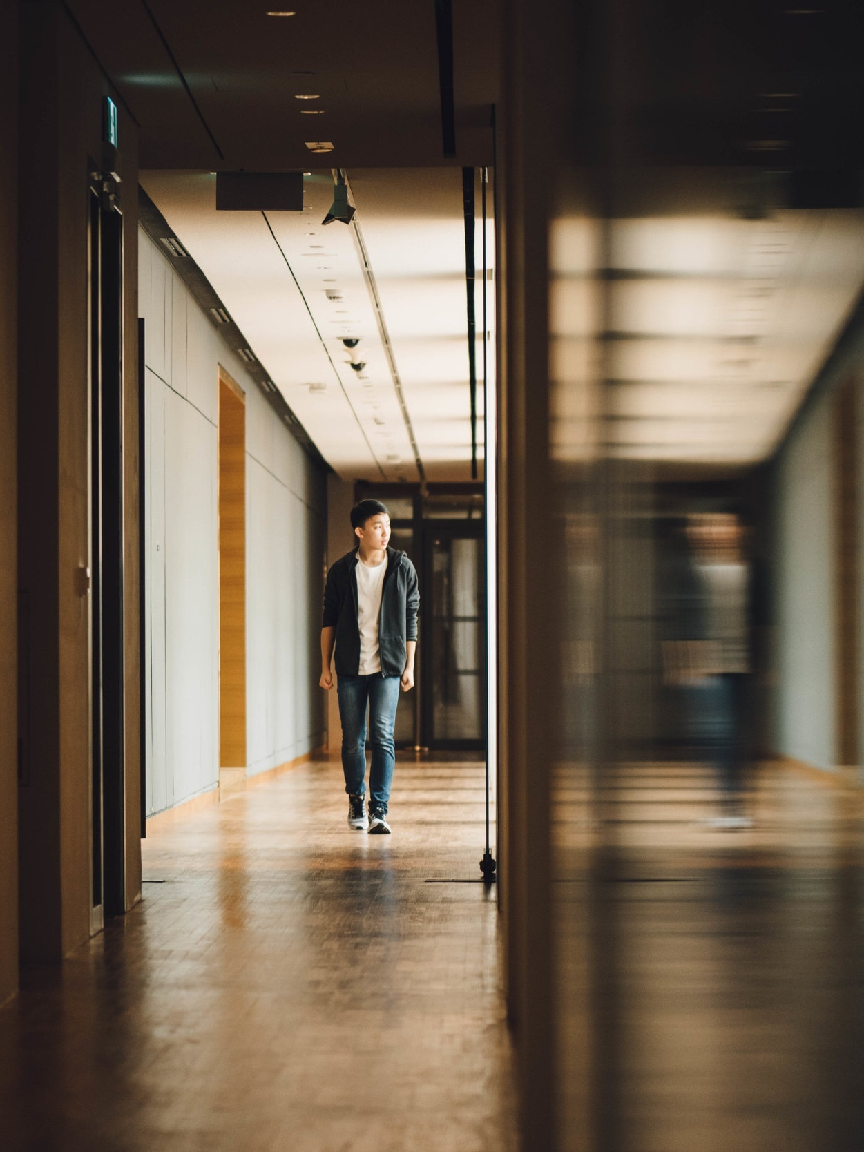 A hallway can now sense when people are nearby and automatically dim or brighten the ambient light. -
