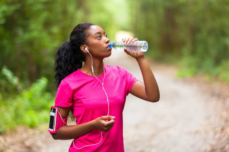 black-woman-working-out-exercise-drinking-water-dreamstime.jpg