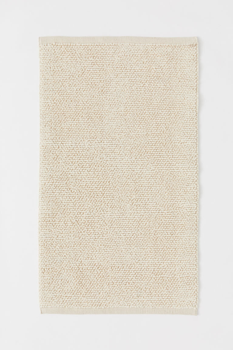 Textured-Weave Wool-Blend Rug - I realize that $59.99 is not cheap when it comes to rugs, but considering what the average price for a quality rug is, this was a steal. H&M Home had a variety that ranged in purpose, size and material.I will say that they don't have the most unique selection of rugs (if you came looking for a unique looking pictorial masterpiece or something that looks like it just got delivered from Persia or Turkey, H&M Home is not the place to shop.) But if you are looking for something basic that is a decent quality for a good price to go under your dining set or under your feet in the living room, they are more than worth checking out.