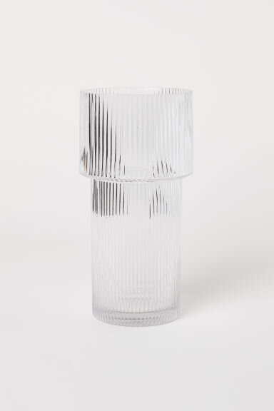 Large Glass Vase - Ferm Living is known for their rippled carafe and cups sets. They're gorgeous, but on the pricier side at 35€ for just the carafe.At 11 inches in height and 5.25 inches in diameter, this is a sizable vase of the same look if you'd like to have a similar accent in your home at a fraction of the price. Admittedly, the glasswork is not at the same level of quality as the Ferm Living products, but it wasn't bad either!
