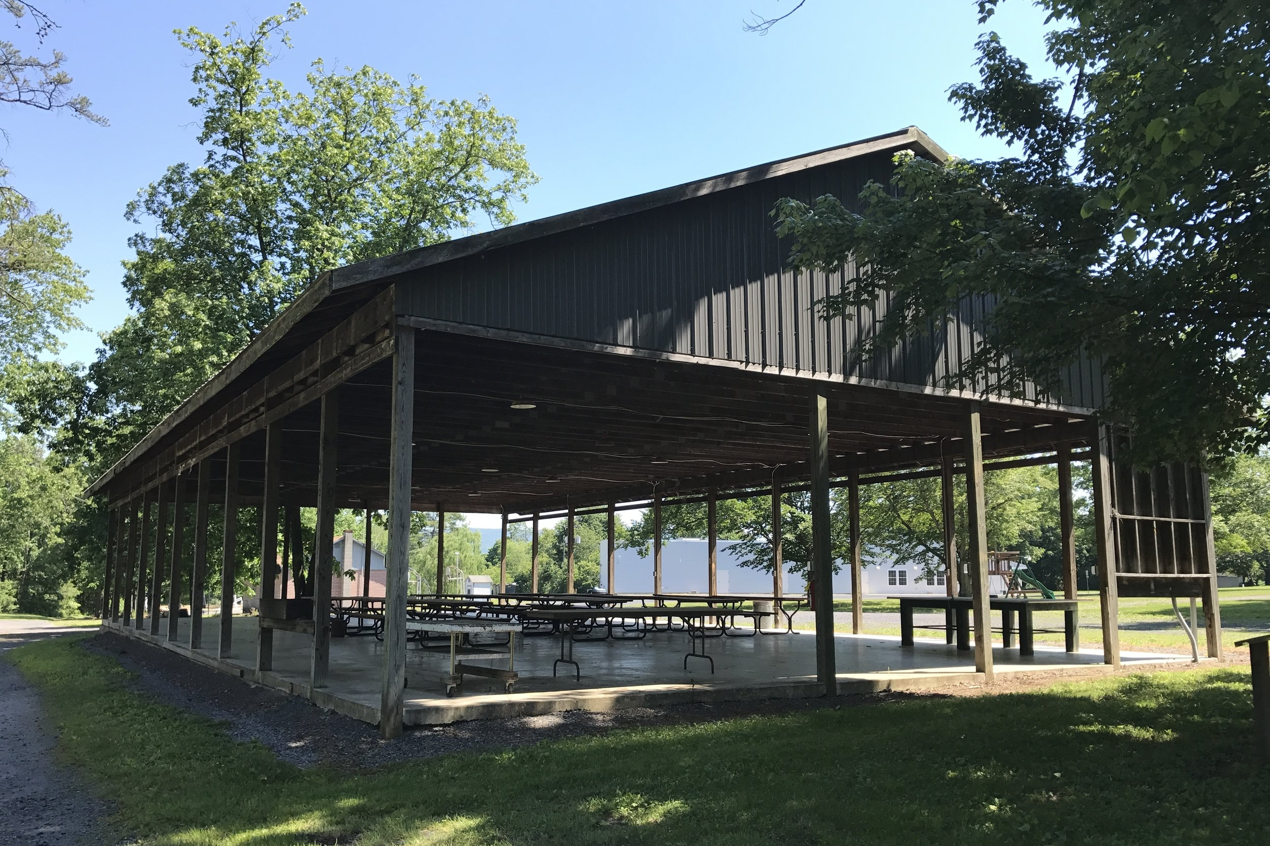 Open Air Pavilion is a paved, covered patio that accommodates up to 150.