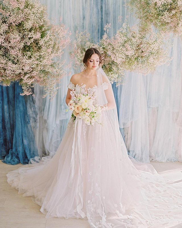 @flowerartistry + @miltonphoto asked us to create a sky tapestry with our handpainted tulle for @flowerartistry's beautiful baby's breath clouds! 😍😍 ... @flowerartistry // floral concept + design @miltonphoto // photography @thelovli.co // handpainted tapestry @myrealnameissteph // model @emiliabeautybridalyyc @emiliabeautyart // HMUA @thebridalboutiqueyyc @galialahav // dress @studio1130 // venue