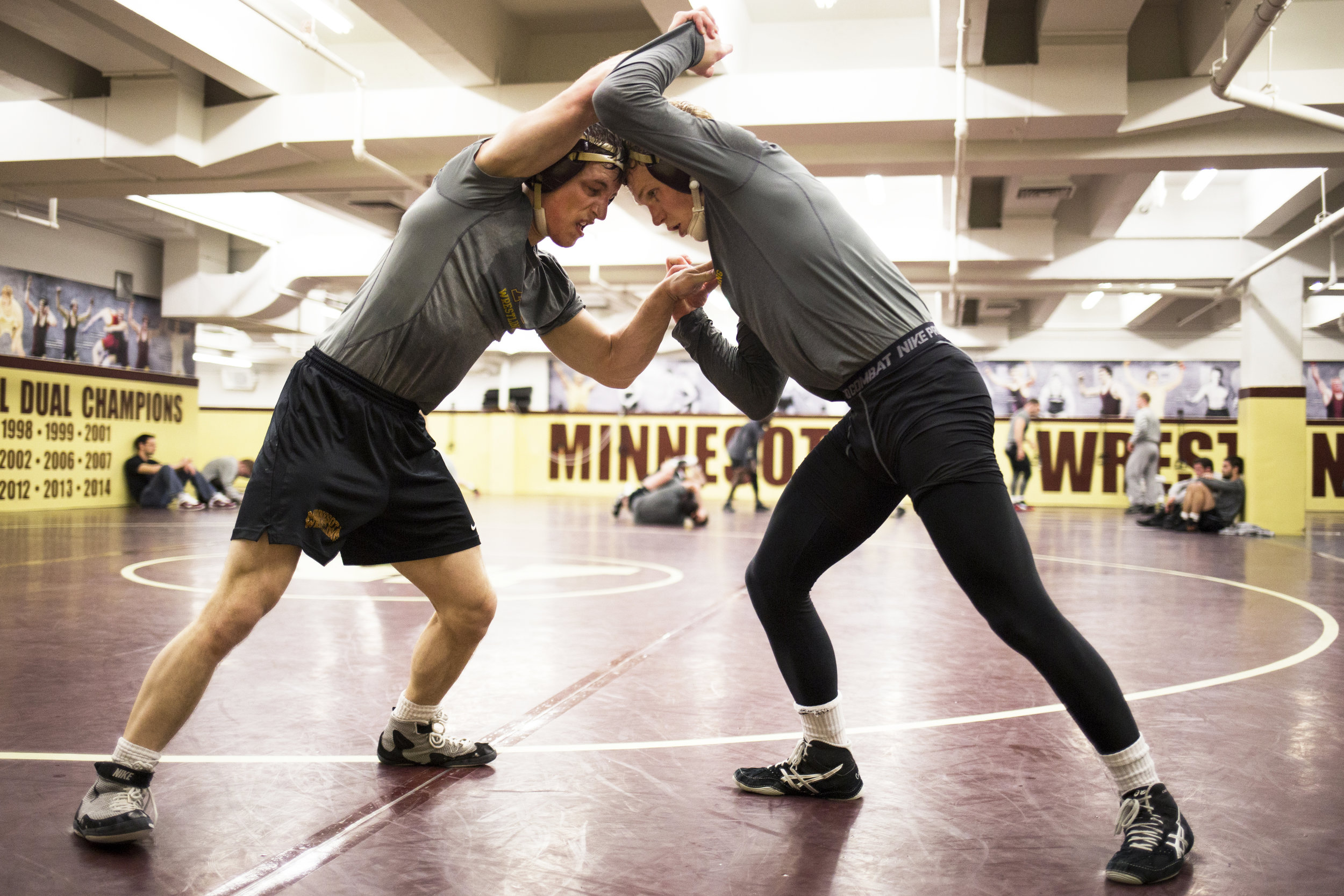 """During a post-practice sparring match, redshirt freshman Skyler Petry and junior Sam Brancale wrestle """"live"""" to emulate a real competition setting while withholding their full effort."""