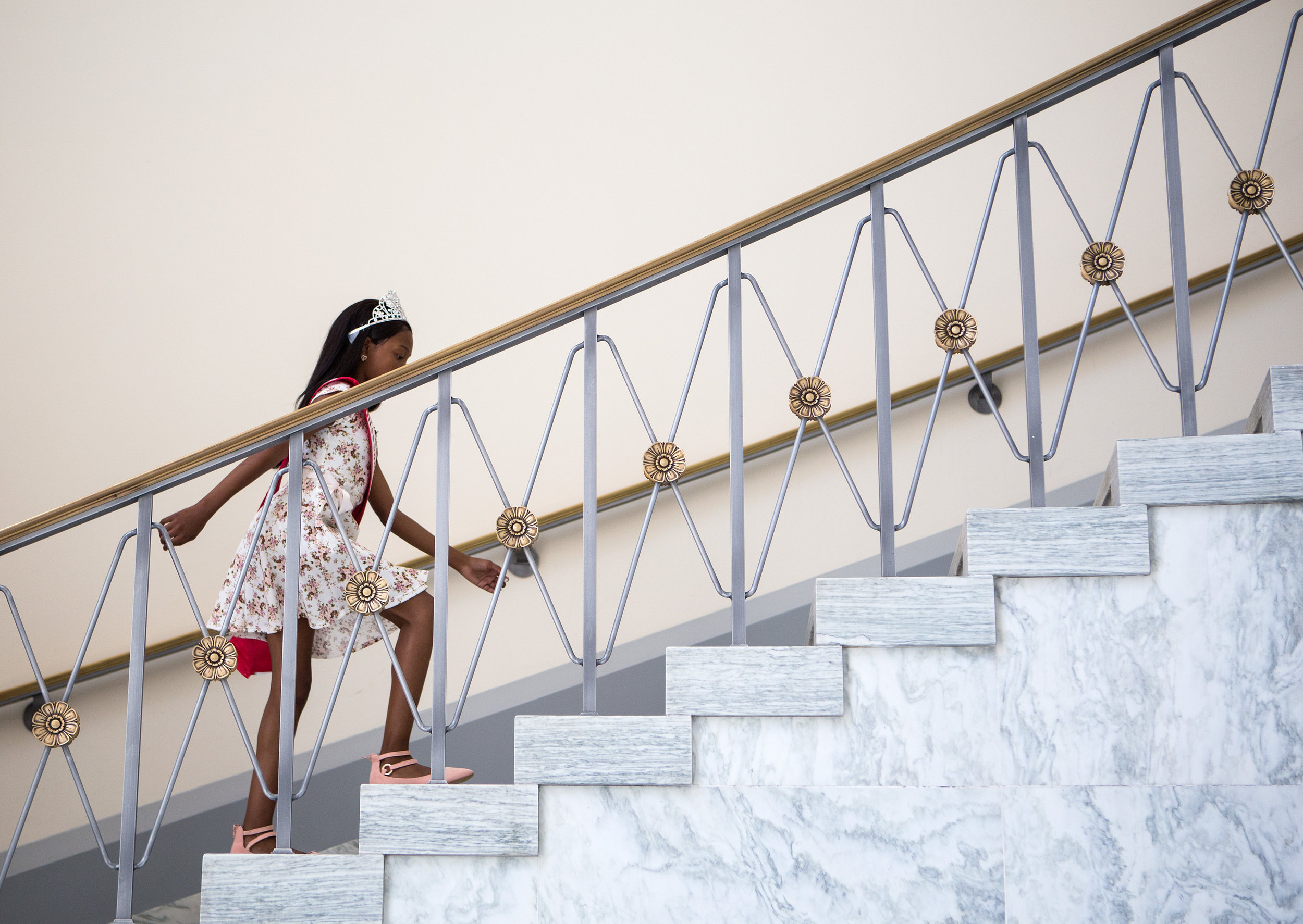 Tymia takes the stairs in the Rayburn House Office Building on her way to meet with Sanford. By the end of the day, she was using a wheelchair. (Liam James Doyle/NPR)