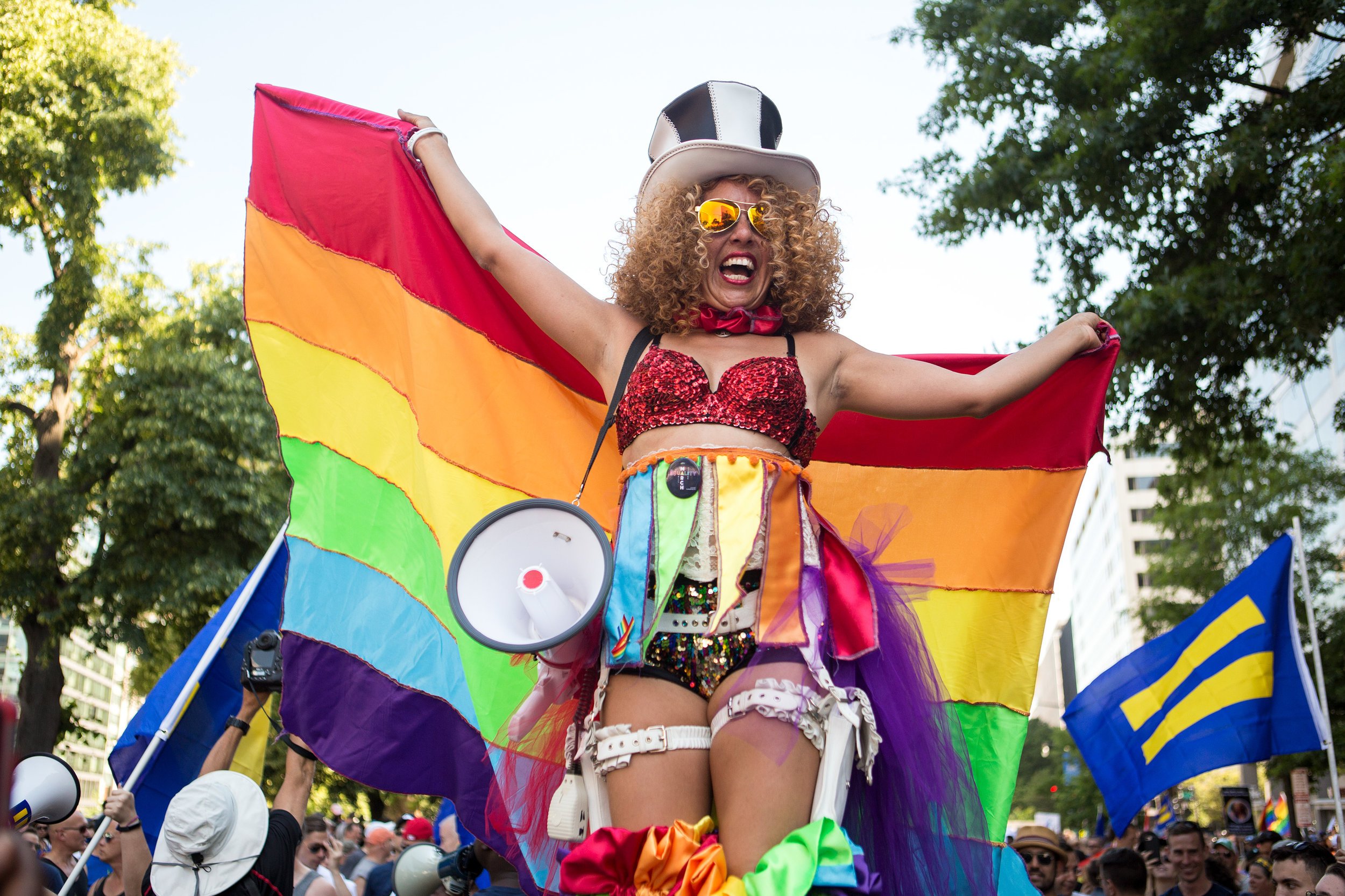 Regina Armenta of Philadelphia, PA cheered from above the crowd atop a pair of stilts during the Equality March in Washington D.C. on Sunday, June 11. (Photo: Liam James Doyle/NPR)
