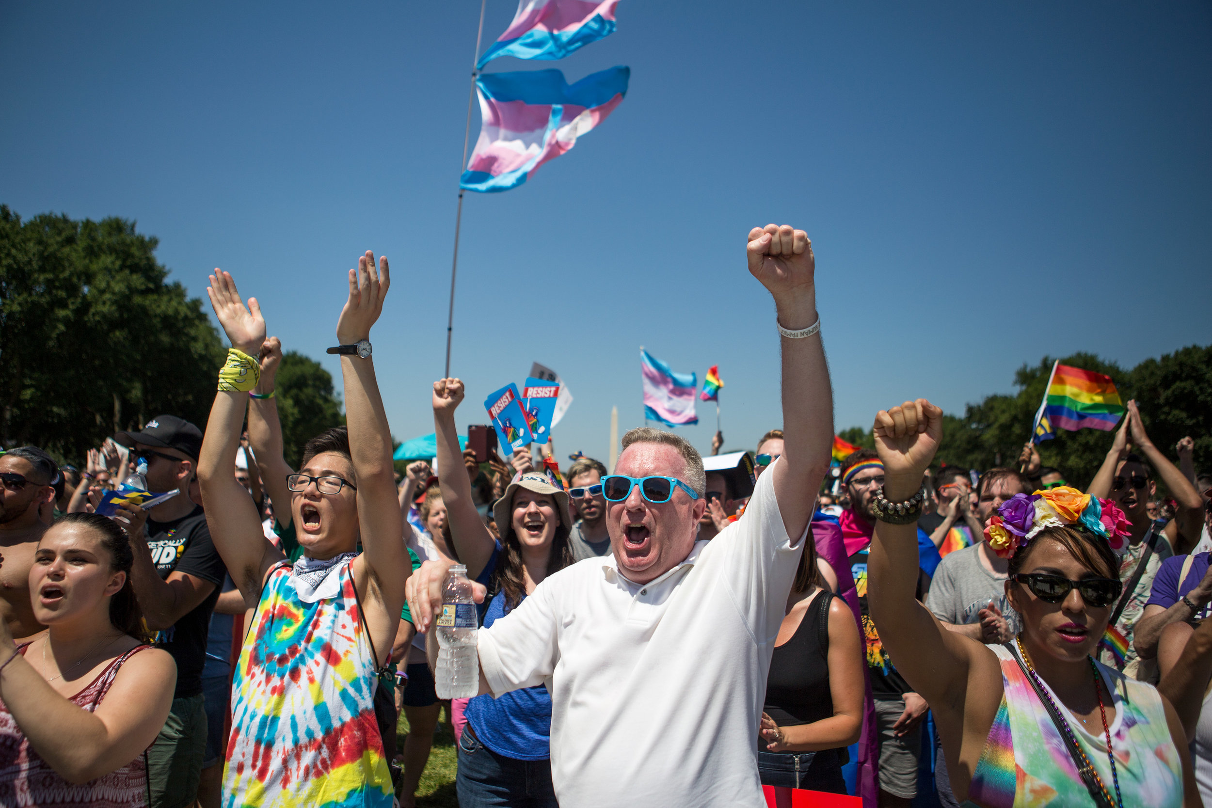 Michael J. Cooper, center, of Arlington, VA cheers alongside a vast crowd of other demonstrators on the National Mall in Washington D.C. during the Equality March on Sunday, June 11. (Photo: Liam James Doyle/NPR)