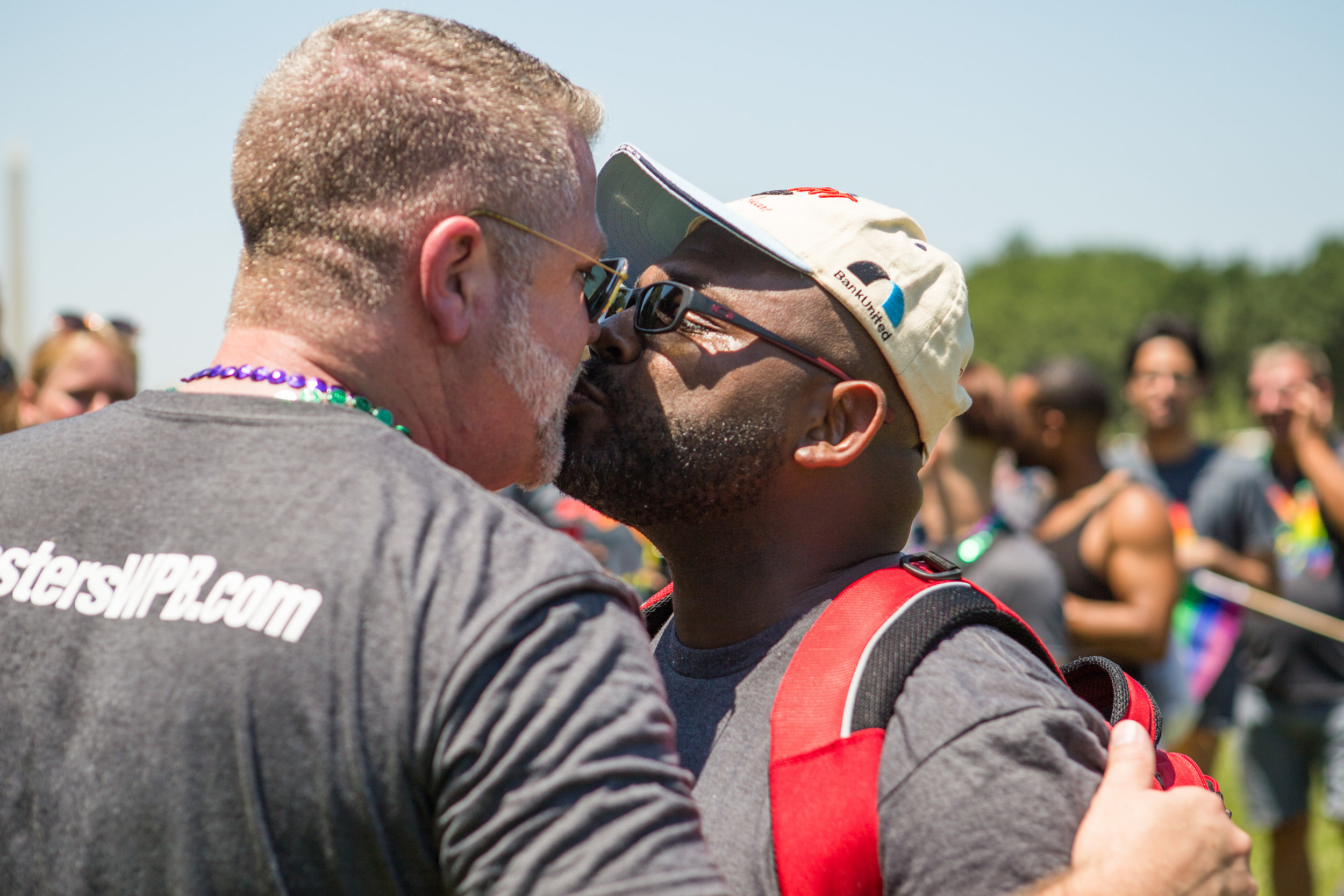 Mike Curtis, left, and Theo Smith of West Palm Beach, FL share a kiss just moments after becoming engaged to get married during the Equality March in Washington D.C. on Sunday, June 11. (Photo: Liam James Doyle/NPR)