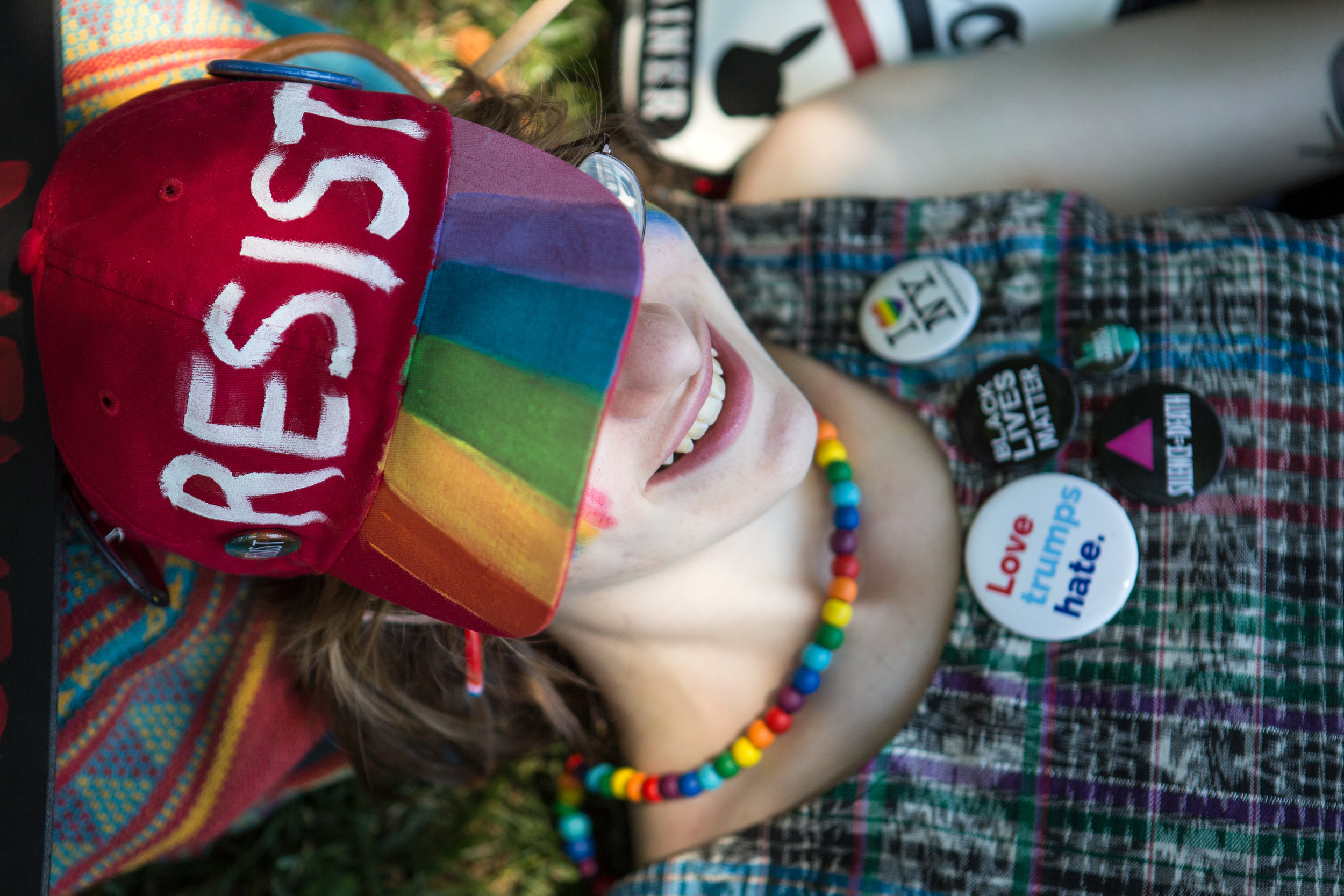 Sarah Corwin of Brooklyn, NY relaxed in the shade on the National Mall during the Equality March in Washington D.C. on Sunday, June 11. (Photo: Liam James Doyle/NPR)