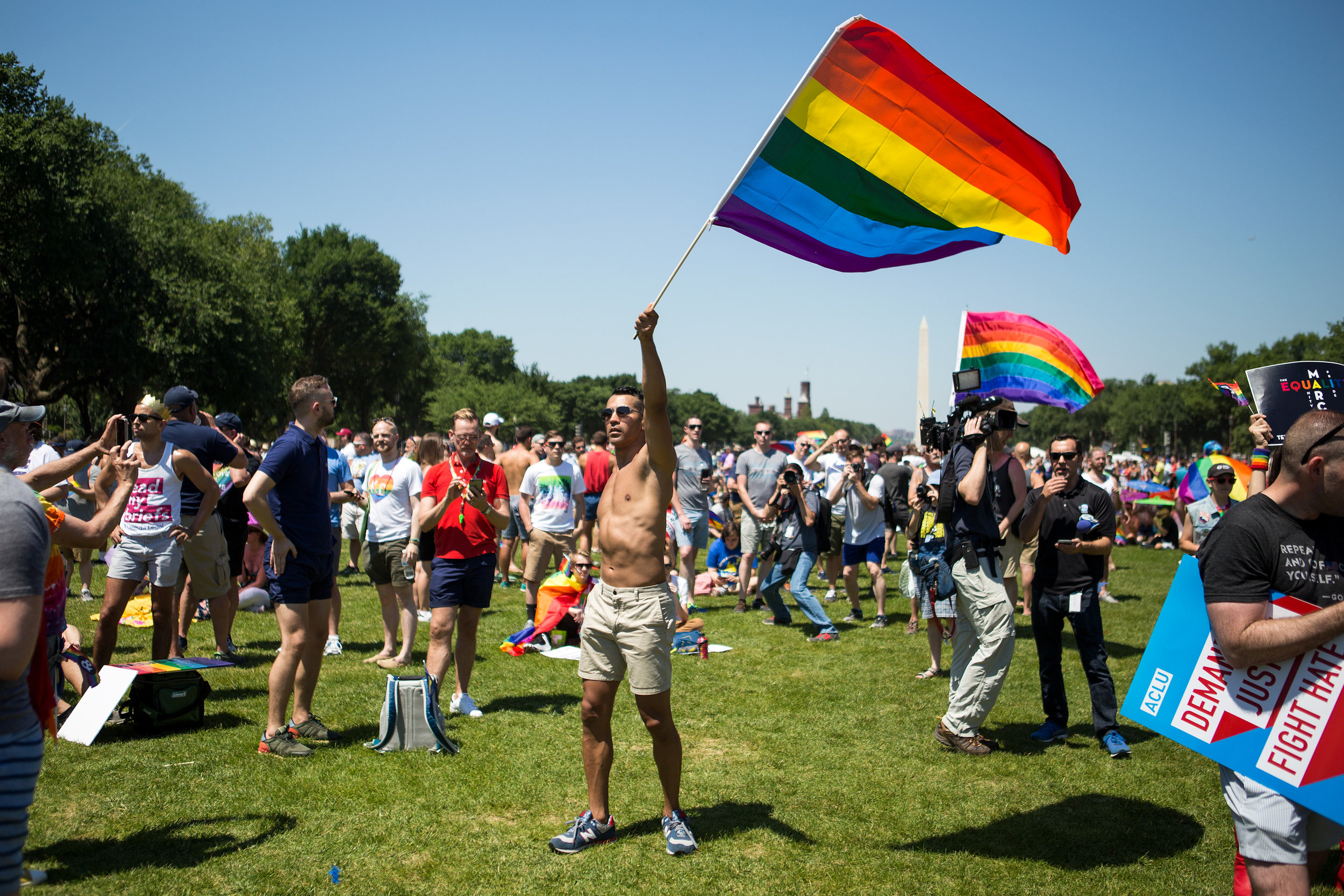 Pride flag in hand, Miguel Perez of Las Vegas, NV, danced on the National Mall during the Equality March in Washington D.C. on Sunday, June 11. (Photo: Liam James Doyle/NPR)