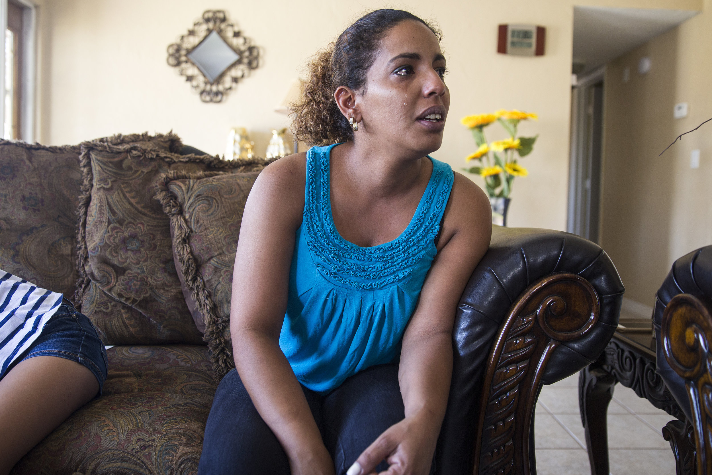 Lidicis Garcia Villafaña cries while remembering her partner of 14 years, Yusdel Moreno Iglesias, who died of a suspected carbon monoxide poisoning this past week.