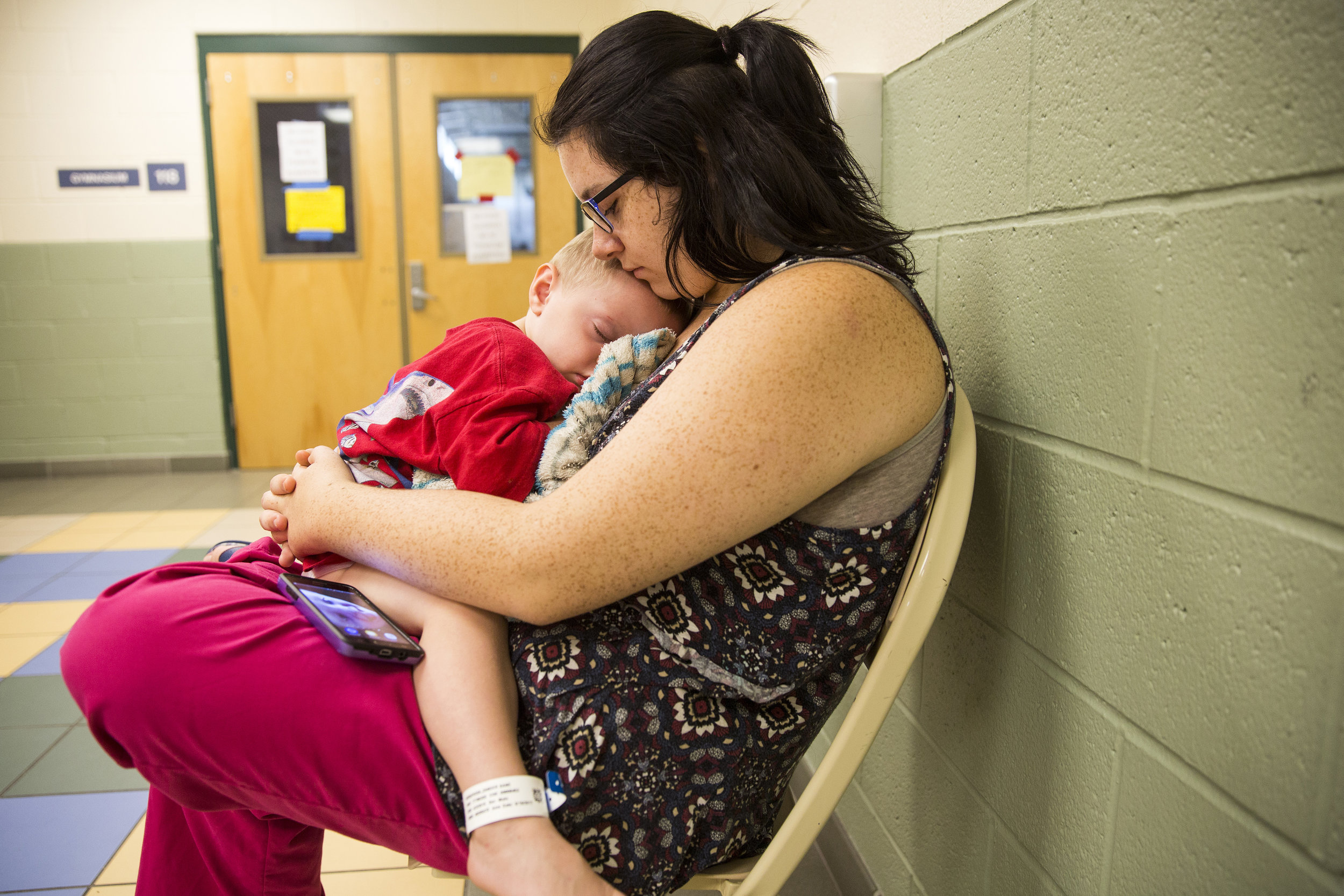 Gillian Verderosa and her 2-year-old son Zander wait for lunch to be served at the Estero Recreational Center, which remains an active emergency shelter under the American Red Cross on Wednesday, September 20, 2017. After sheltering initially at Florida Gulf Coast University and then Germain Arena, Verderosa hopes to secure a new living situation soon.