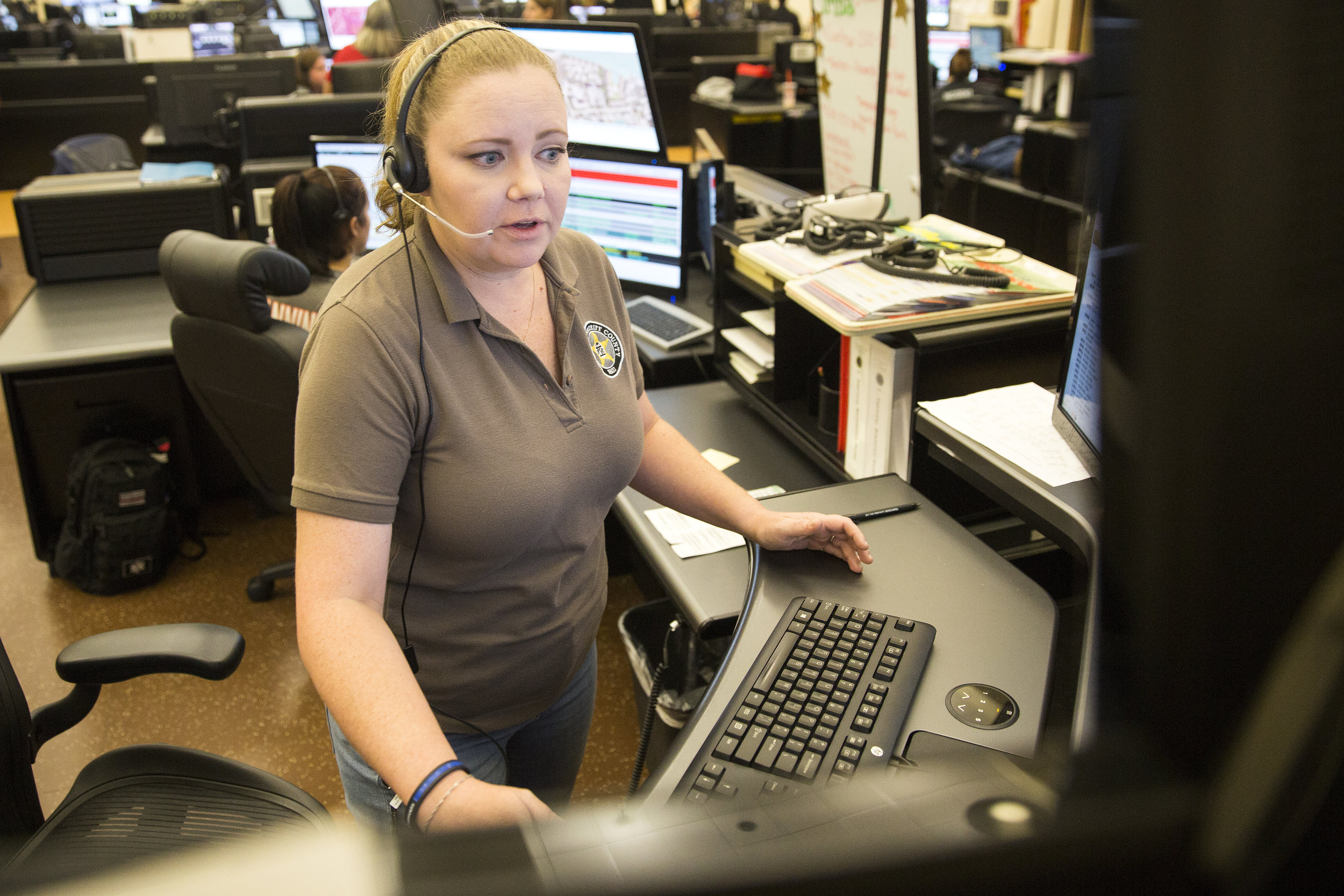 Dispatcher Mandy Ptak came from Baldwin County in Georgia to help with the high volume of emergency calls received in the wake of Hurricane Irma at the Collier County Emergency Services Center on Friday September 22, 2017.
