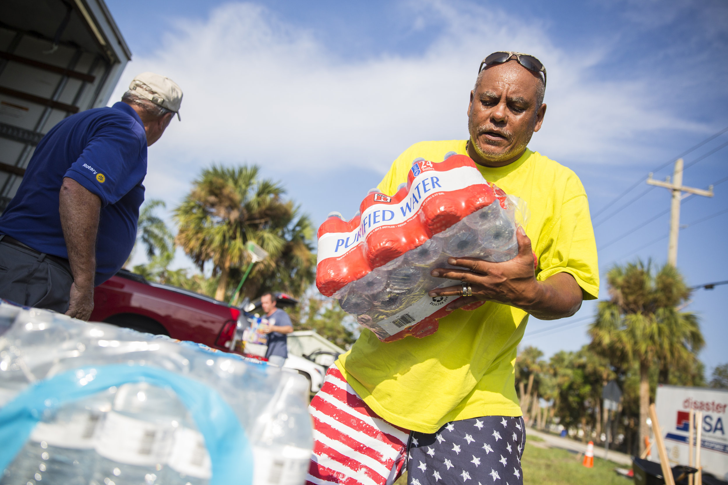 Rodney Malone helps unload a truck of provisions from the American Red Cross in Bonita Springs on Tuesday September 26, 2017.