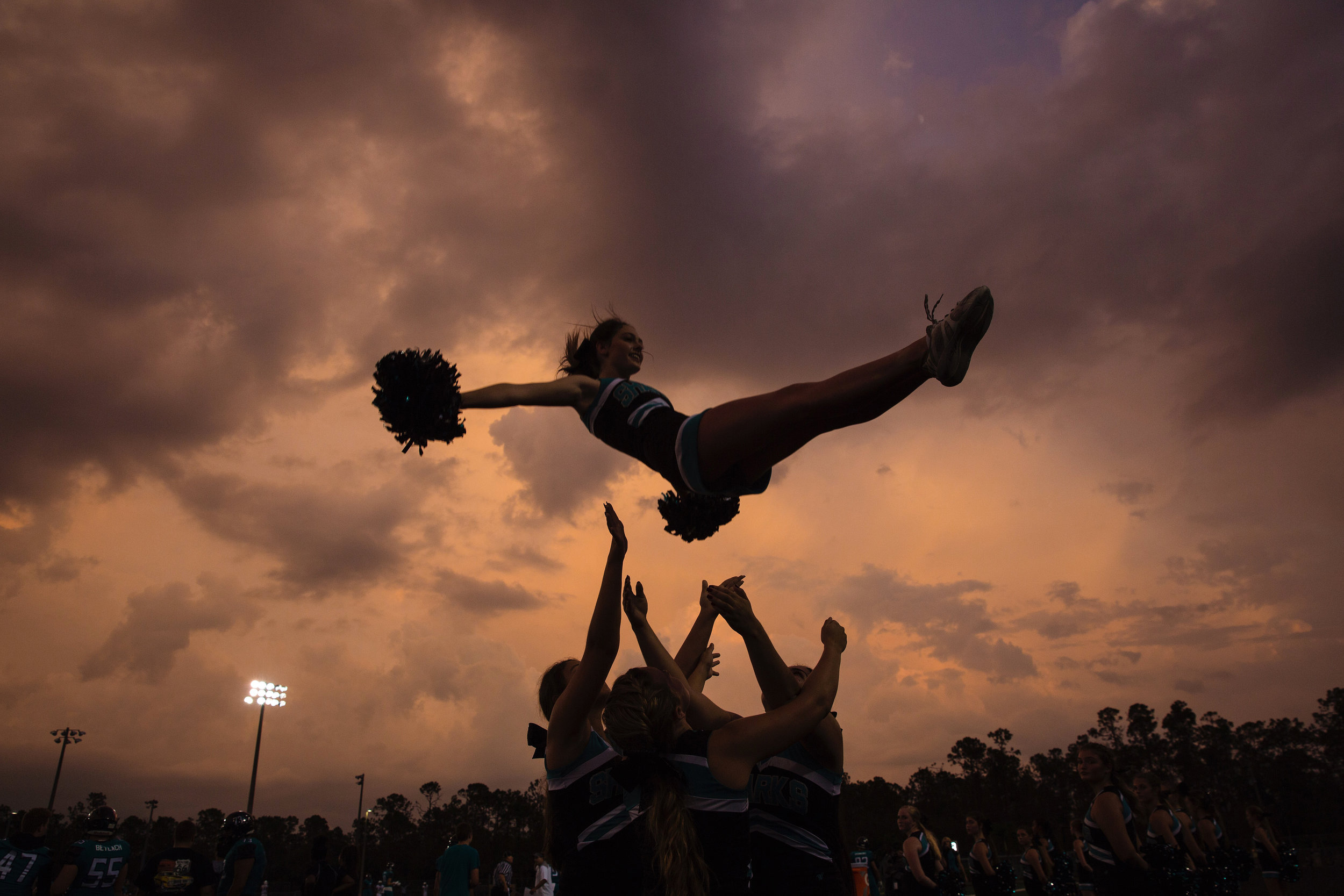 Gulf Coast High School cheerleaders pumped up the crowd at Golden Gate High School in Naples where the Sharks took on the Riverdale Raiders on Thursday, September 28, 2017.