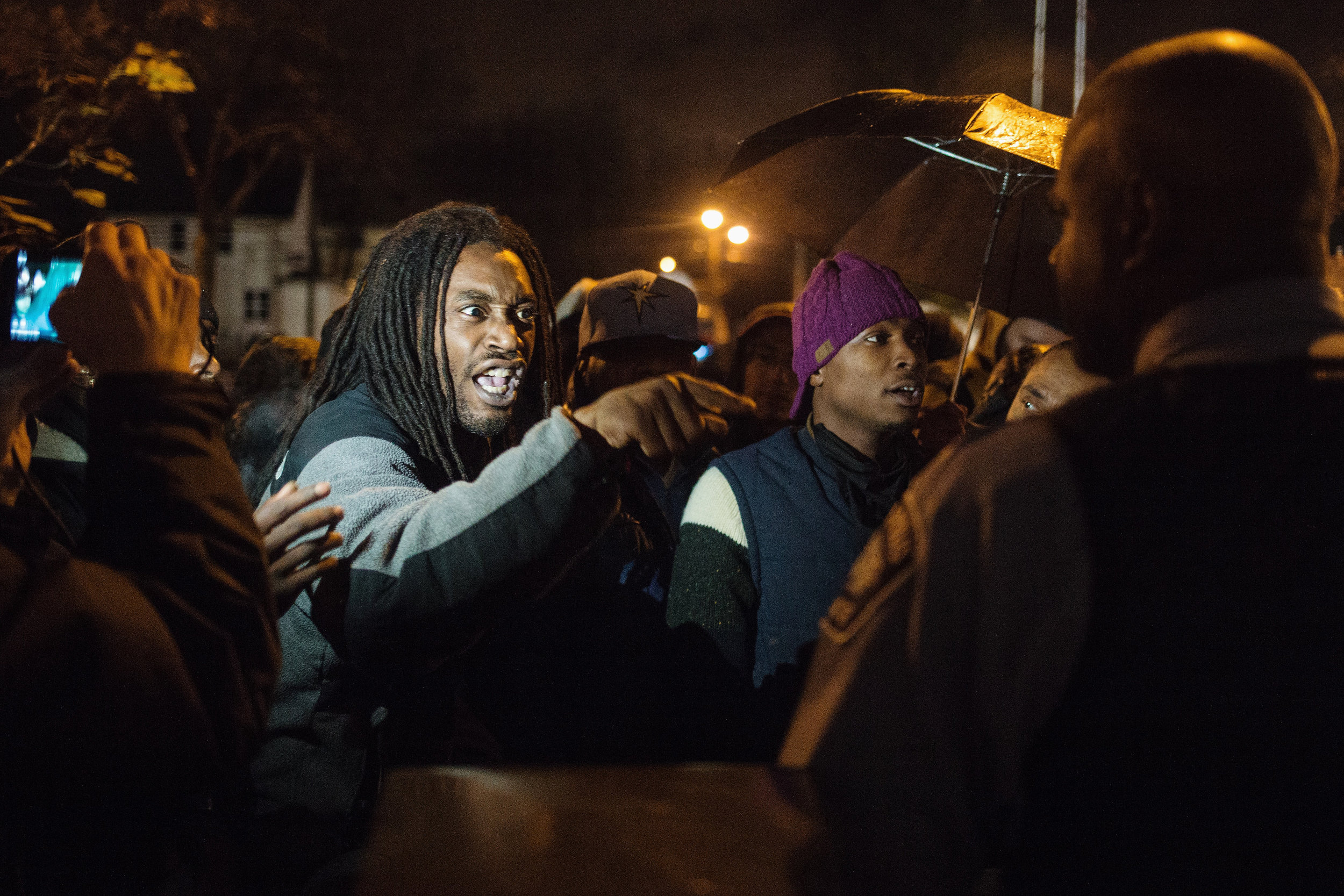 Christon Hickman, 30, of North Minneapolis confronts MPD Lt. Arthur Knight outside of the front entrance of the 4th Precinct on Wednesday evening, Nov. 18, 2015.