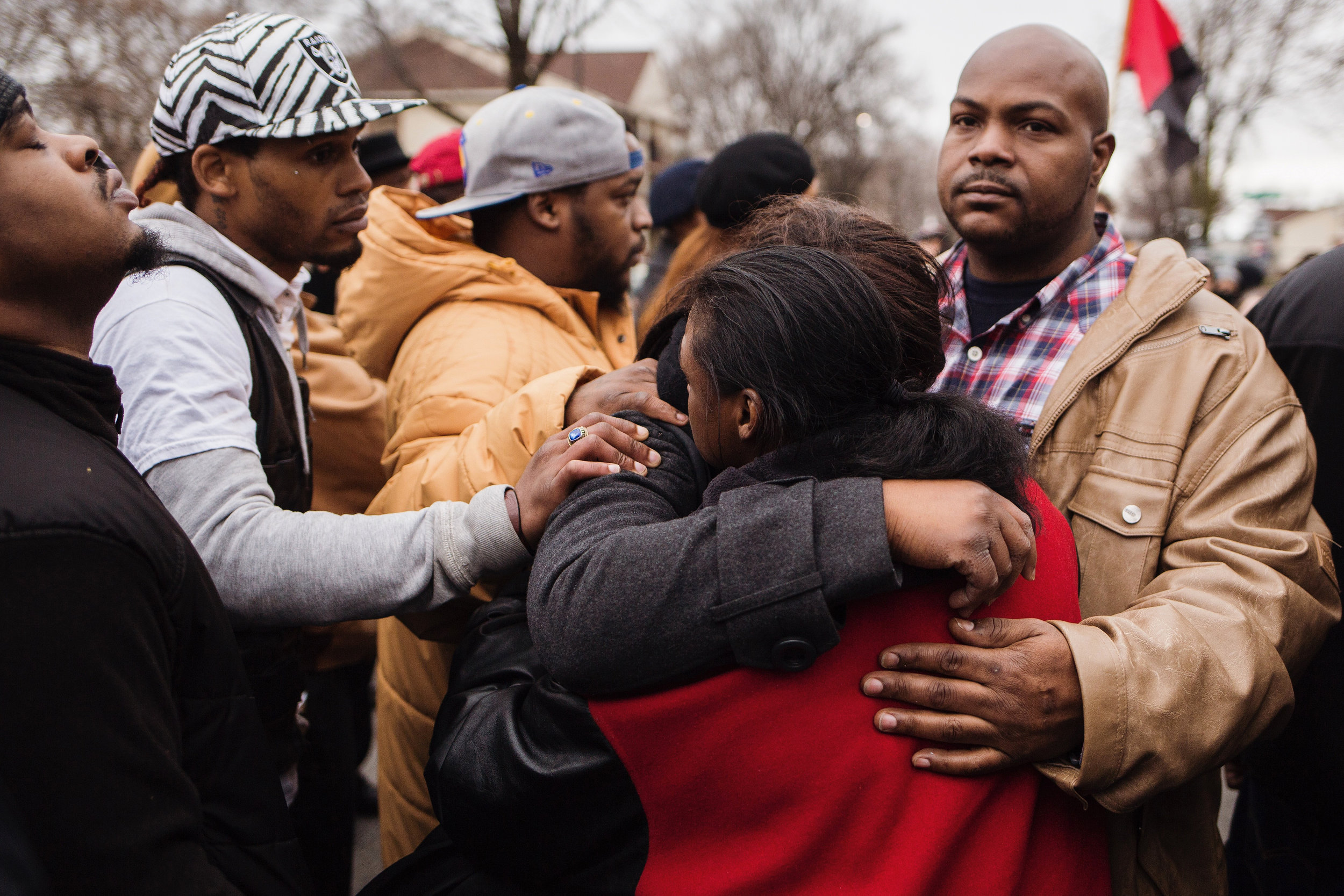 Members of Jamar Clark's family mourn together at the site of his shooting on Plymouth Ave. N on Wednesday, March 30, 2016. While some demonstrators marched to the Hennepin County Government Center, others chose to remain behind at the memorial. The day's demonstrations came after Hennepin County attorney Mike Freeman announced his decision to not charge MPD officers Mark Ringgenberg and Dustin Schwarze, who were involved in Clark's death.