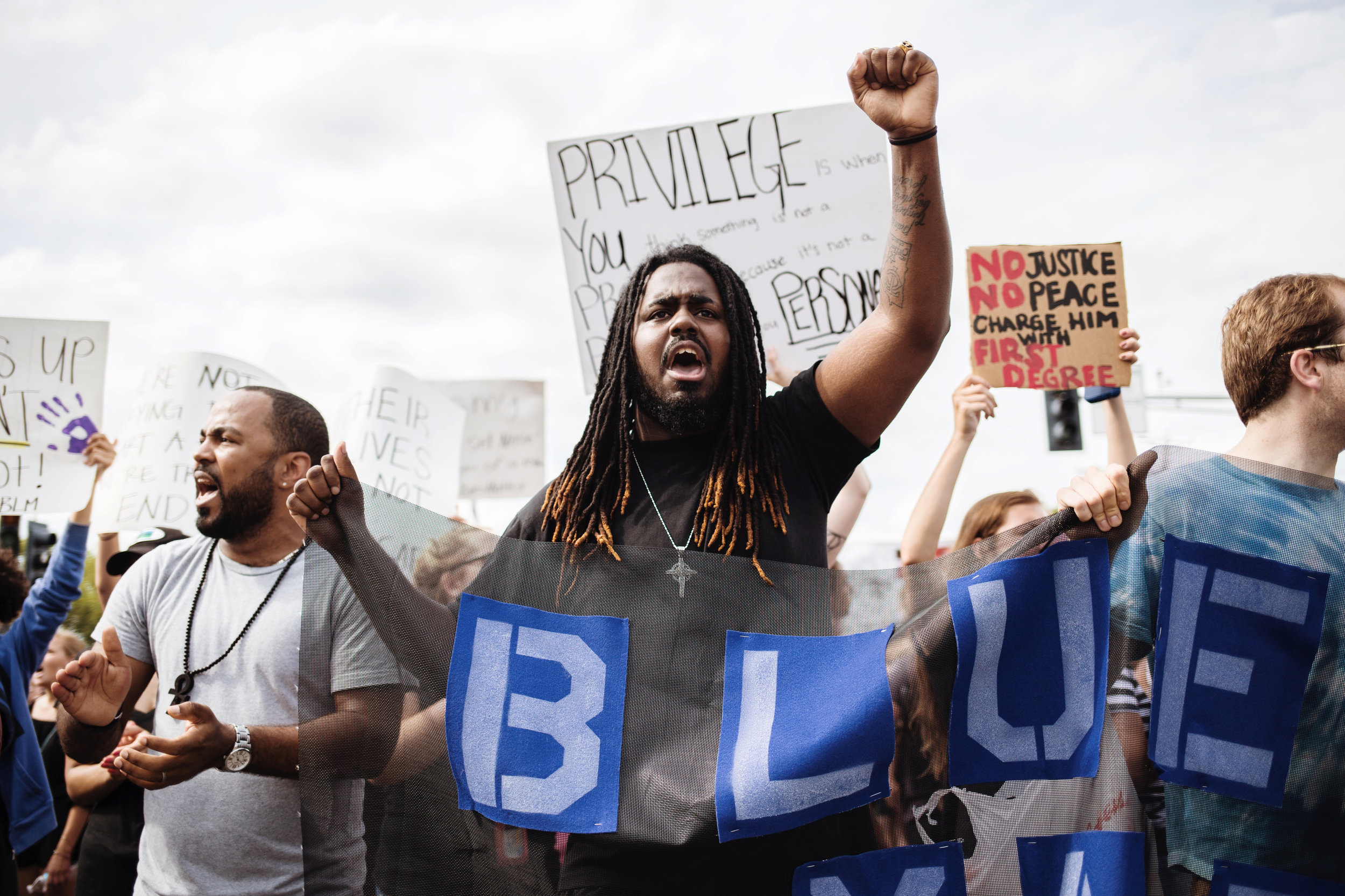 Aaron Allen of St. Paul cried out chants alongside other protesters during a march that followed a rally outside of the St. Anthony Police Department, where a crowd demanded justice for Philando Castile on Sunday, July 10, 2016.