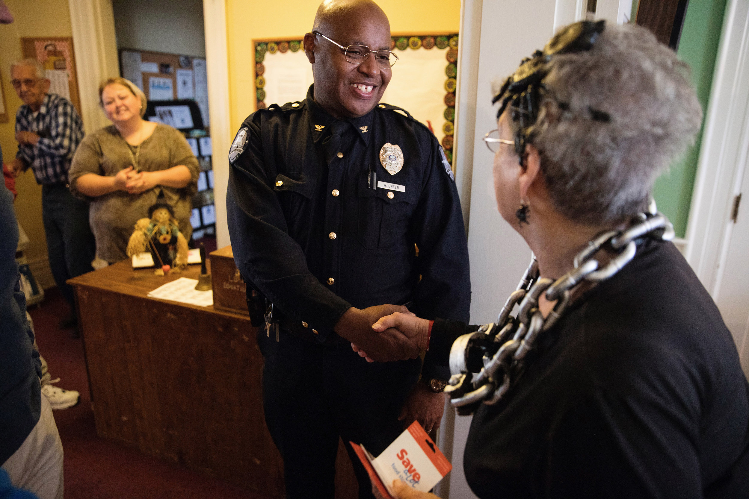 Wayne congratulates Ann Dragoo, the winner of the chili cook-off. As chief, Wayne takes pleasure in being present for community events like this where he can represent and be a face for the police department.