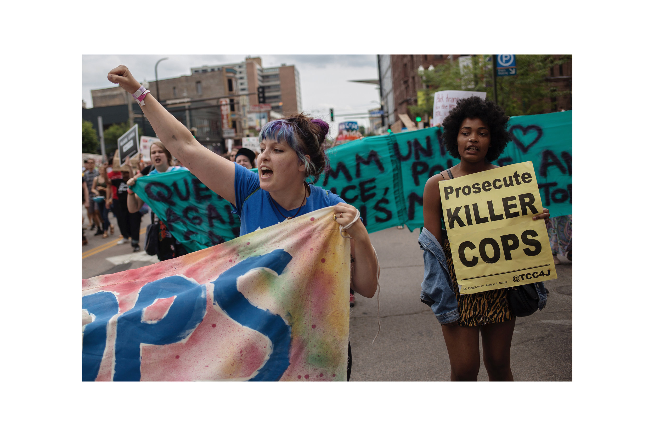 Protestors occupied Hennepin Avenue in downtown Minneapolis on June 24, delaying the start of the Twin Cities Pride Parade by almost two hours. The impassioned demonstrators called from the removal of police presence from Pride events, as well as justice for Thurman J. Blevins, a 31-year-old man who had been shot and killed by police in north Minneapolis the night before. Reactions from the crowd ranged from passive silence, to signs of solidarity, to booing. For MPR News.