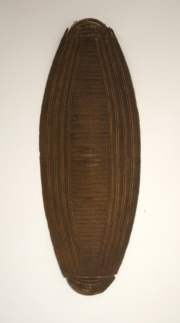 Anonymous,  Ngbundu Shield, Congo (DRC), Congo-Brazzaville, Central African Republic,  c. 1930s-40s, Woven plaited plant fibers, 54h x 18w x 1/2d in.