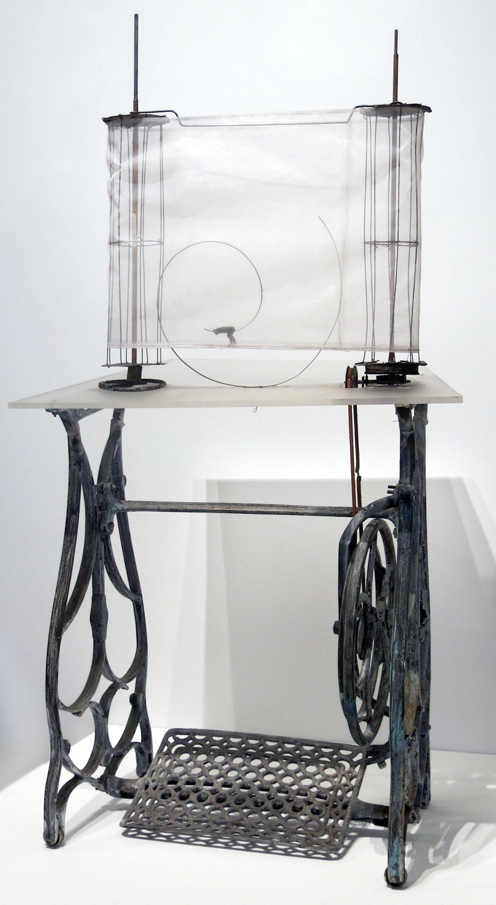 June Leaf, Figure Running on the Seam , 2014, Cast iron, tin, plexiglas, mesh, acrylic, leather, 50h x 26w x 20.25d in.