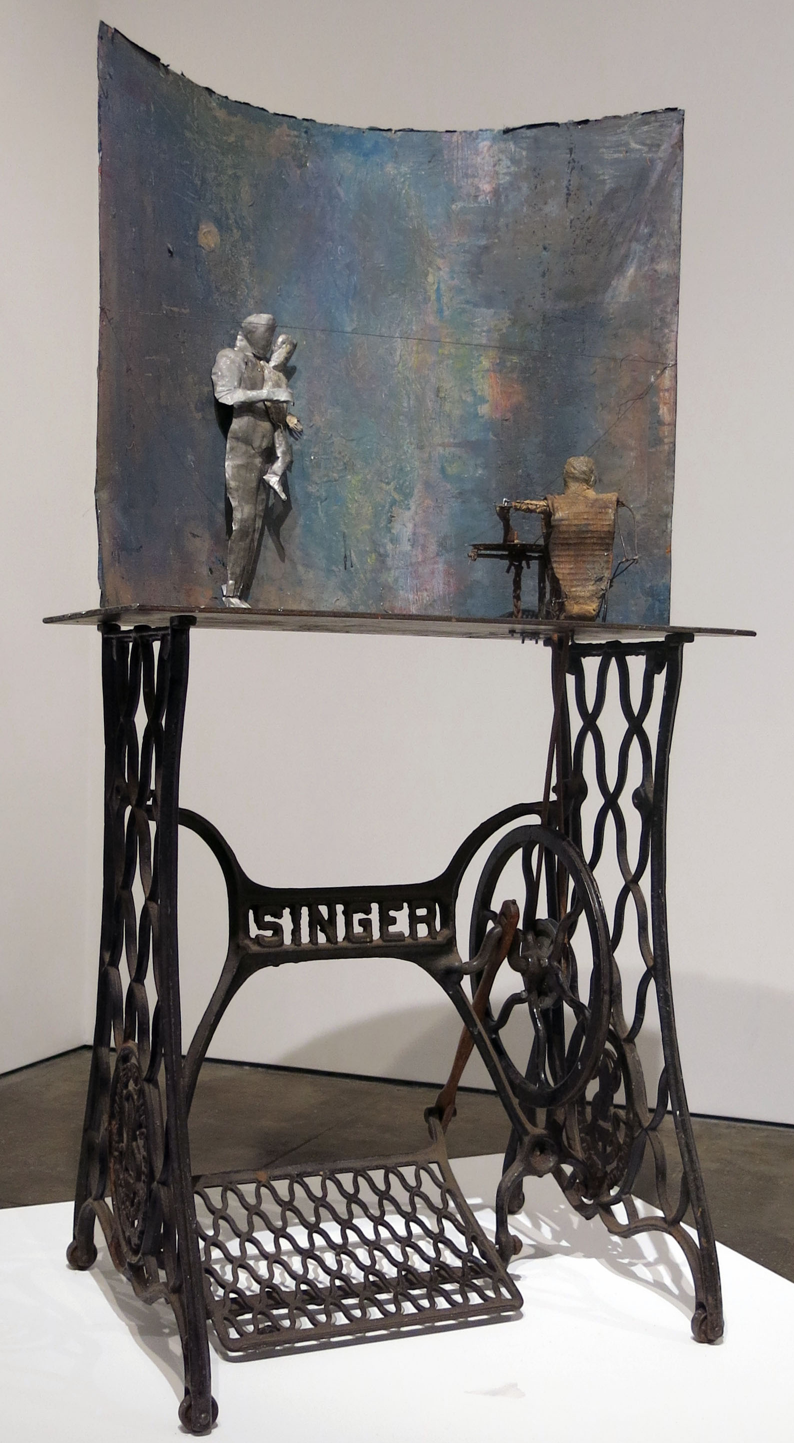 June Leaf,  Bernie,  2011-2015, cast iron, steel plate, tin, painted canvas figure, 51h x 18.5w x 15.25d in.