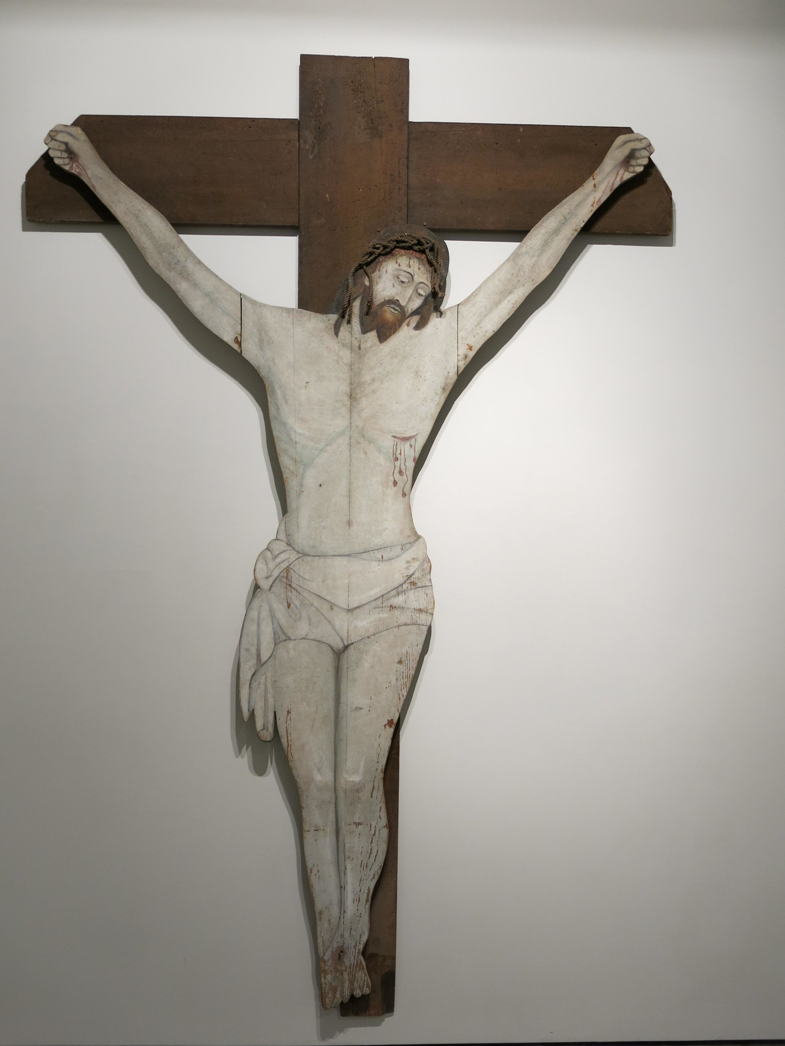 Anonymous, North American, Crucifix, c. 1900, wood and rope with original paint, 107h x 70w x 3.5d in.