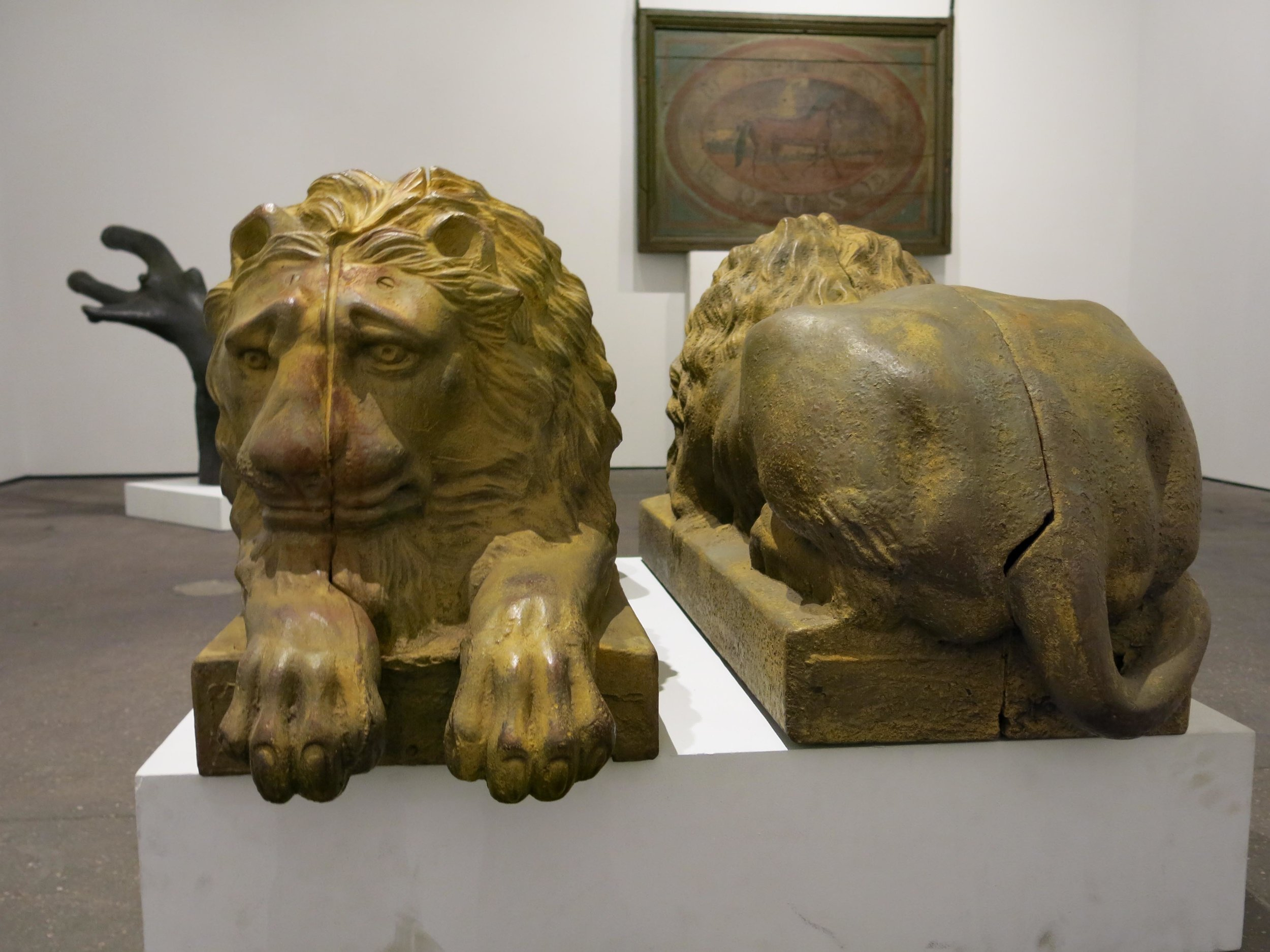 Attributed to J. W. Fiske, New York, Pair of Cast Iron Lions, circa 1880, cast iron with old yellow paint, 36h x 20w x 20d in. (ea.)