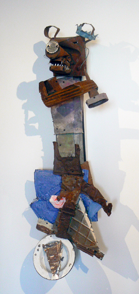 Matthew Blackwell,  Why he Goes (Over the Hill),  2013, tin, galvanized metal, paint can, screws, oil paint, plaster, archival tape, 50h x 18w x 11d in.