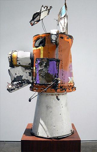 Matthew Blackwell,  Bear Head III,  2011, metal, ceiling tin, enamel, caulk, wire, plastic, 35h x 17w x 18d in.