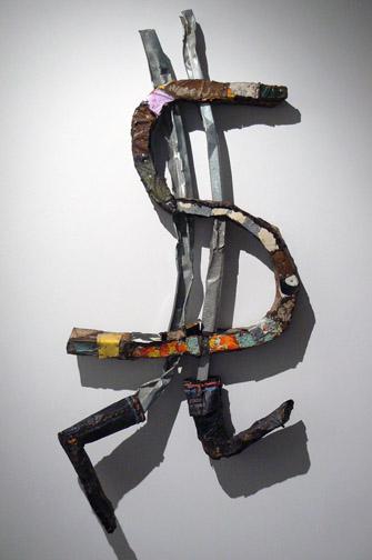 Matthew Blackwell,  Dollar Sign,  2010-2011, tin, metal studs, enamel, 55h x 28w x 8d in.