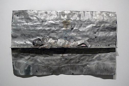June Leaf,  Sleeping Woman,  2011, tin & acrylic, 20.5h x 32.5w x 2.5d in.