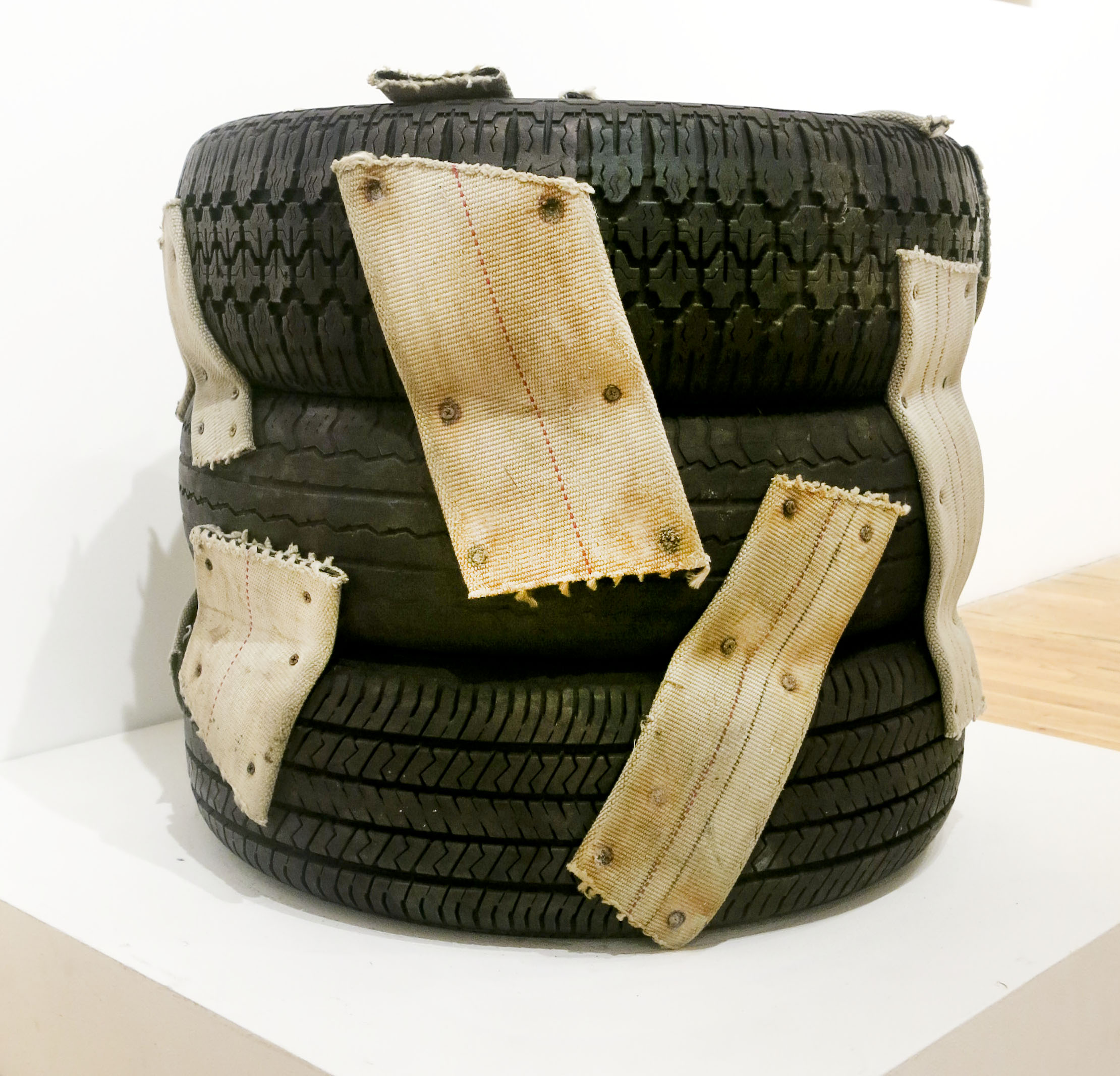 Nari Ward,  Nanny, Nanny, Nanny,  1993, tires, nylon straps, and dry wall screws, 23h x 26w x 26d in.
