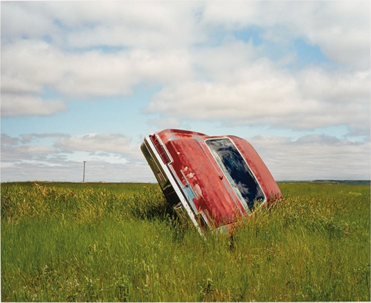 Jeff Brouws,  Route 248 (Car in Landscape), Montana,  2004, archival pigment print, 20h x 24w in.