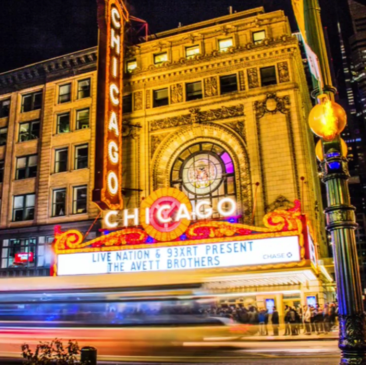 """Across the street, lights from the Chicago Theatre's marquee burst through the dimming twilight."" Original photo credit: Travon Printis"
