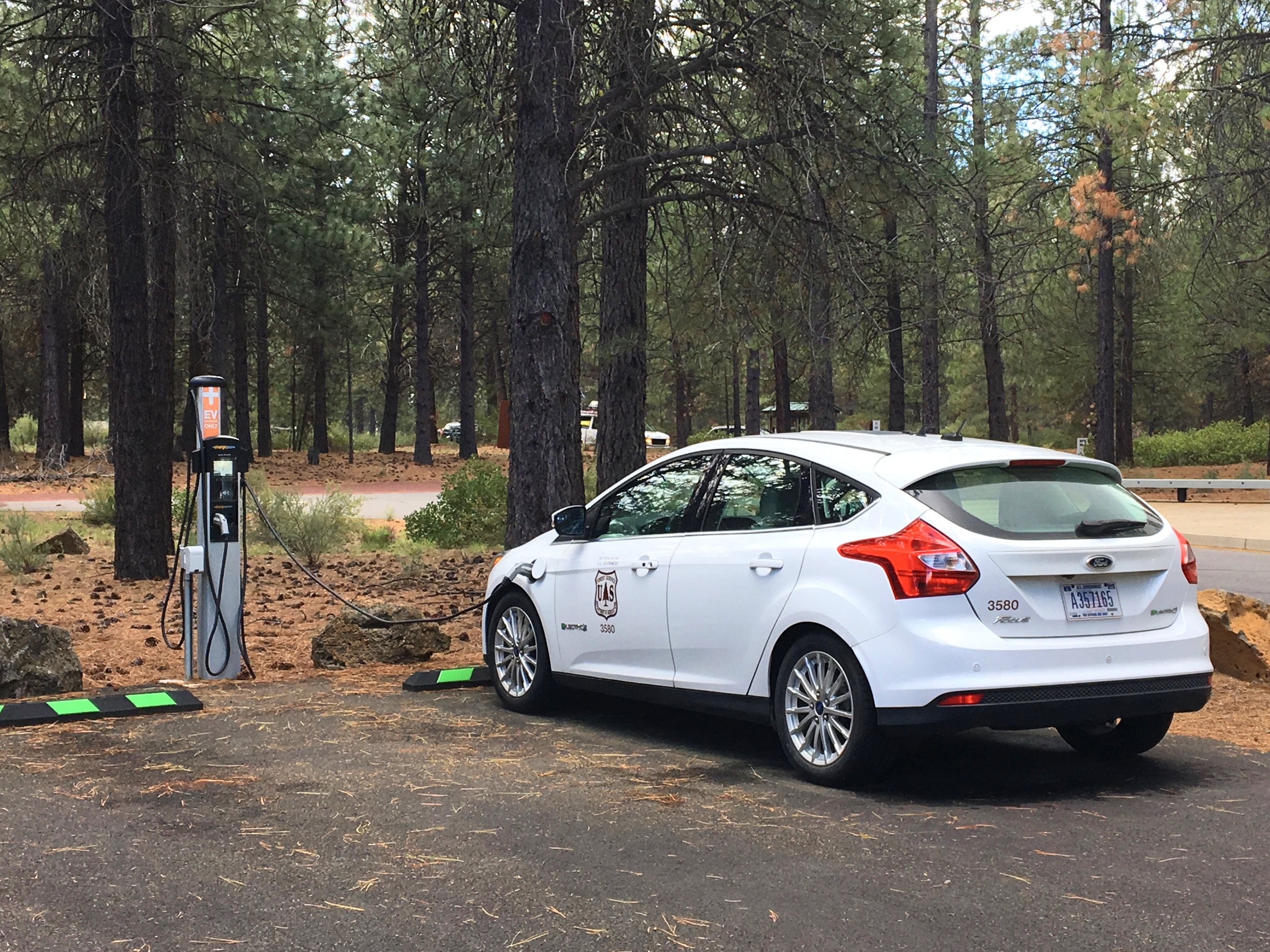 The U.S. Forest Service charges up their electric vehicle at Lava Lands Visitor Center, part of the  Newberry National Volcanic Monument .