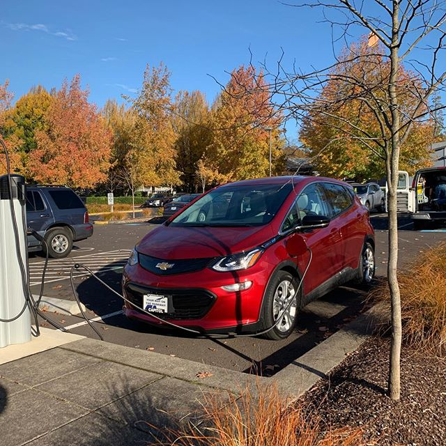 From @odoenergy  This all-electric Bolt sure looks nice charging up with the fall colors in the background.  #goelectricor #electricvehicle #zeroemissions #chargeupandgo #bolt #ev #electriccar