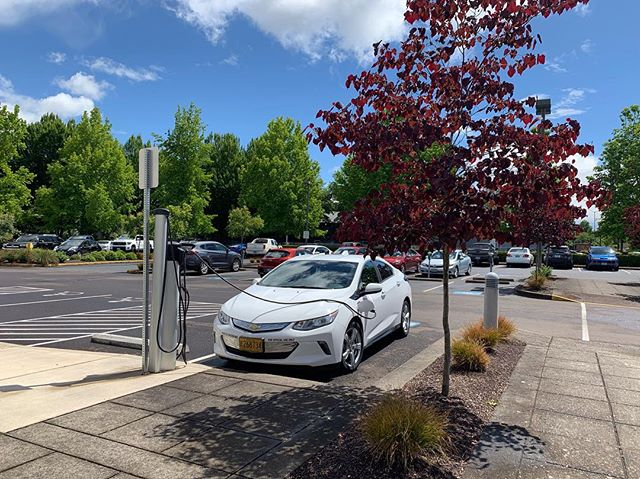 From @odoenergy  Electric vehicle charging on a late spring day. ☀️💐🔌 #electricvehicle #chargeupandgo #oregon #oregonenergy #GoElectricOR #electriccar #chevyvolt #volt #EV #zeroemissions