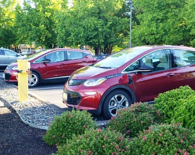 We spotted these Bolt Twins chatting about the weather in our parking lot.  #GoElectricOR #electricvehicles #chevybolt #electriccar #chargeupandgo #evcharger #zeroemissions