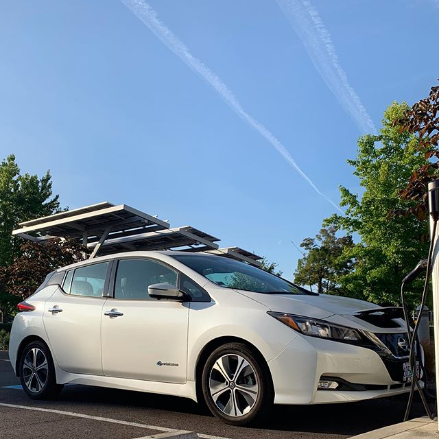 A Nissan LEAF charges up in that early morning light. 😍 #GoElectricOR #LEAF #ZEV #electricvehicle #zeroemissions #chargeupandgo #plugin #oregonenergy