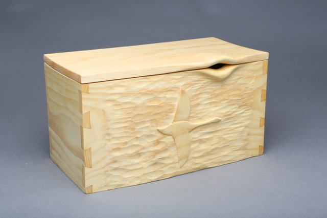 """Doug Raymond - Doug builds wooden boxes with classic dovetail joinery with the added dimension of carved surfaces. He is inspired by different kinds of wood and lives in the woods of Montville. His work has been shown at Aarhus Gallery, The Harlow Gallery, River Arts Gallery and recently, a one-man show at Chestnut Street Loft Gallery. See Hawk Hollow Woodworks for additional pieces. Painting, carving, or a combination of the two make up the bulk of his work. Doug feels, """"Every artistic attempt is a challenge. That challenge is a gift."""""""