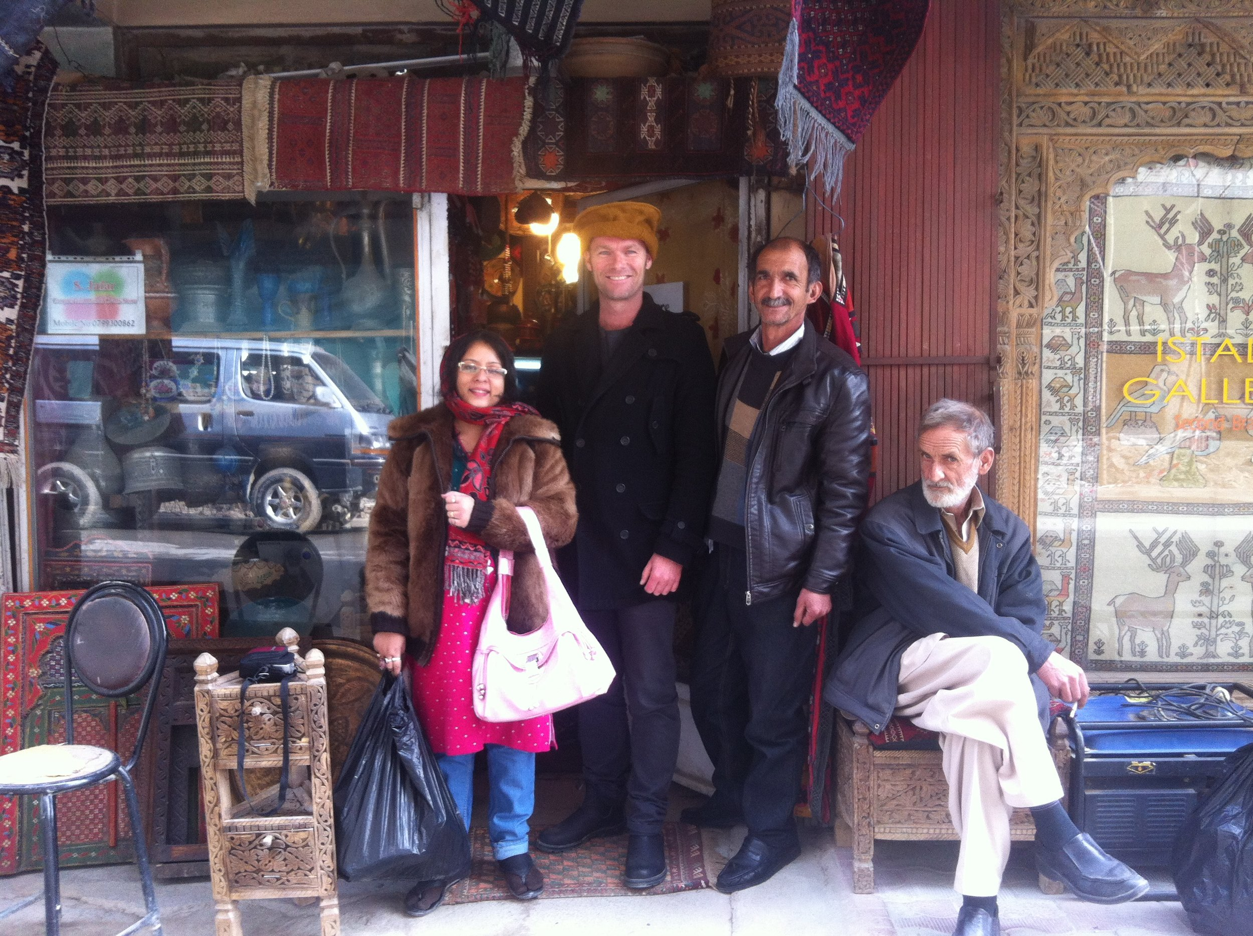 Me with two ANIM colleagues and an elderly merchant on Chicken Street in Kabul, 2015.
