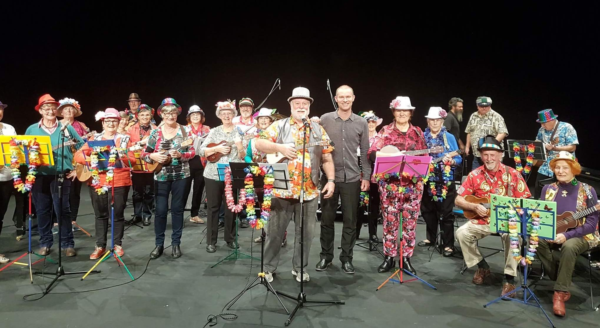 The full ukulele ensemble, what a colourful bunch!