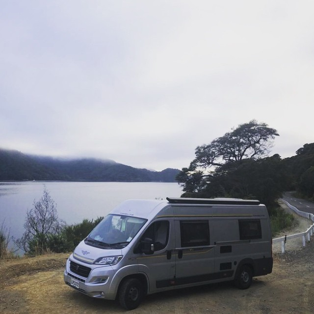 One of the joys of road-tripping NZ in a @sunriseholidays camper is pulling over and enjoying a cup of tea, anywhere that feels right. Freedom and comfort, simple pleasures on the road. #Robyn the #piwakawaka campervan here is feeling good and enjoying the view at Aussie Bay, #queencharlottesound #malborough #aotearoa #newzealand #beautifulnzcampervanholidays #nzsunriseholidays #nzsunrise #autotrail #680